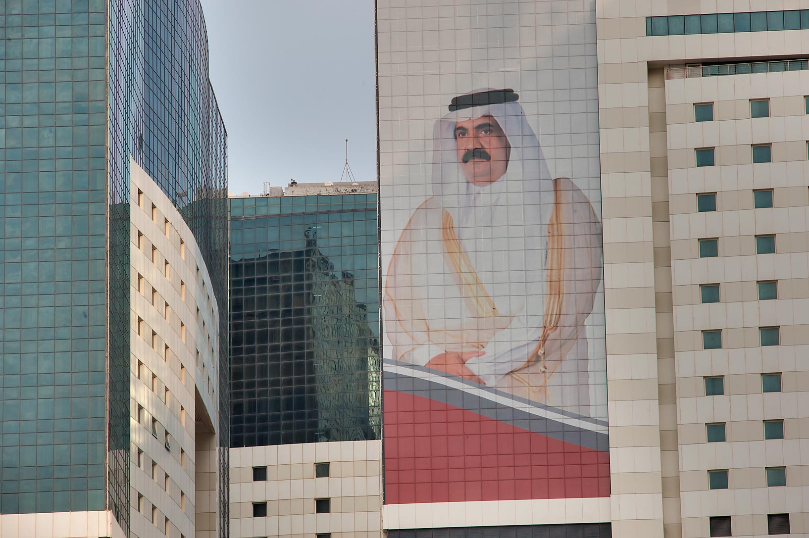 Giant portrait of a former emir Hamad bin Khalifa...Ezdan Tower in West Bay. Doha, Qatar