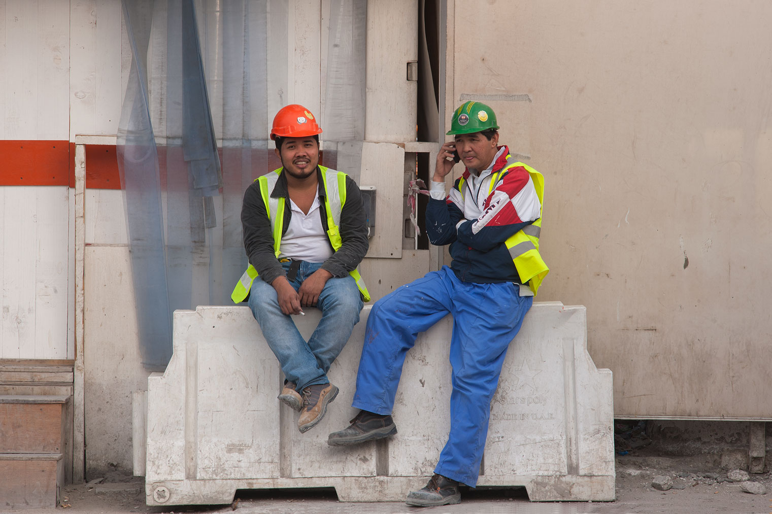 Workers on construction of QP Building resting...Al Adaid St. in West Bay. Doha, Qatar