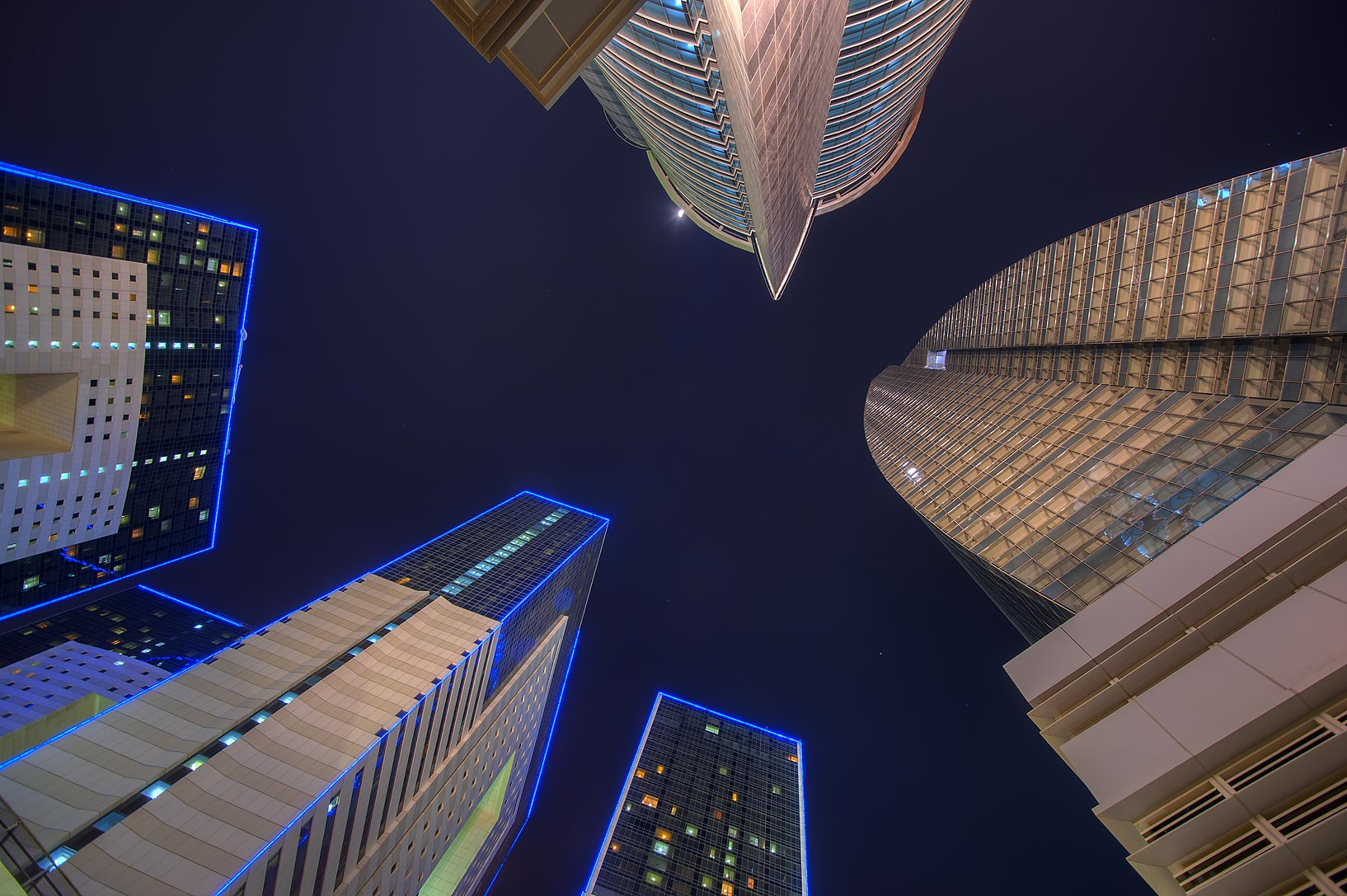 Buildings around Ezdan Hotel at Al Betra St. in...at evening, looking up. Doha, Qatar