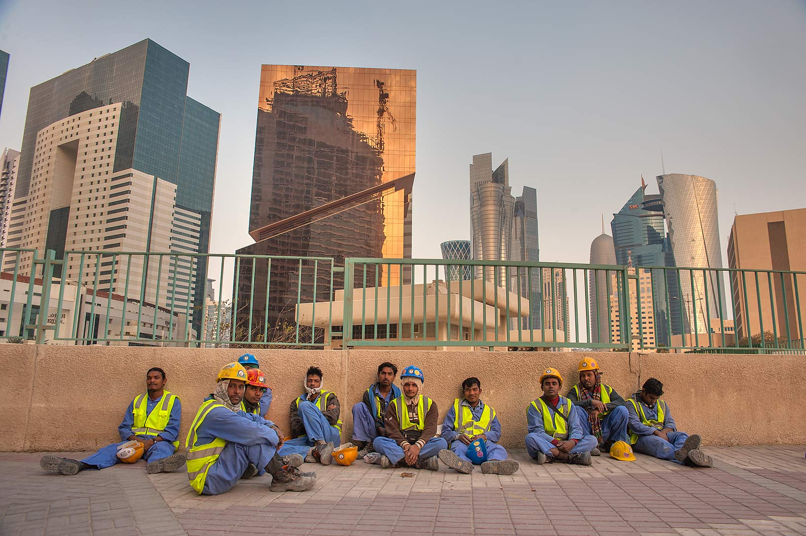 Group of workers on construction of Qatar...at sunset after a shift. Doha, Qatar
