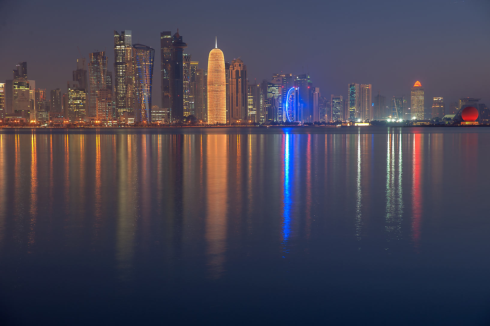 Glowing towers of West Bay from Corniche Promenade. Doha, Qatar