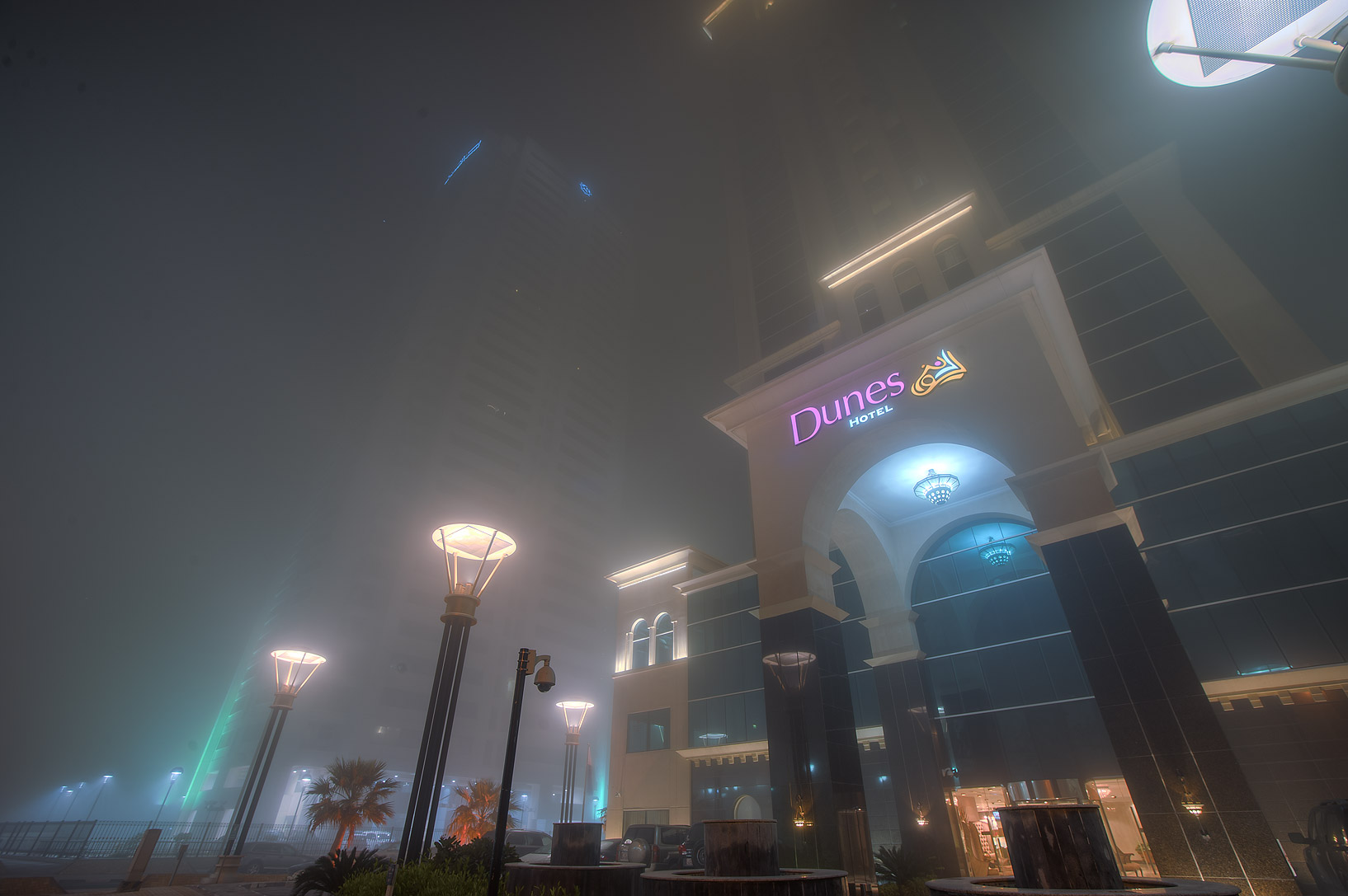 Dunes Hotel in West Bay in fog. Doha, Qatar