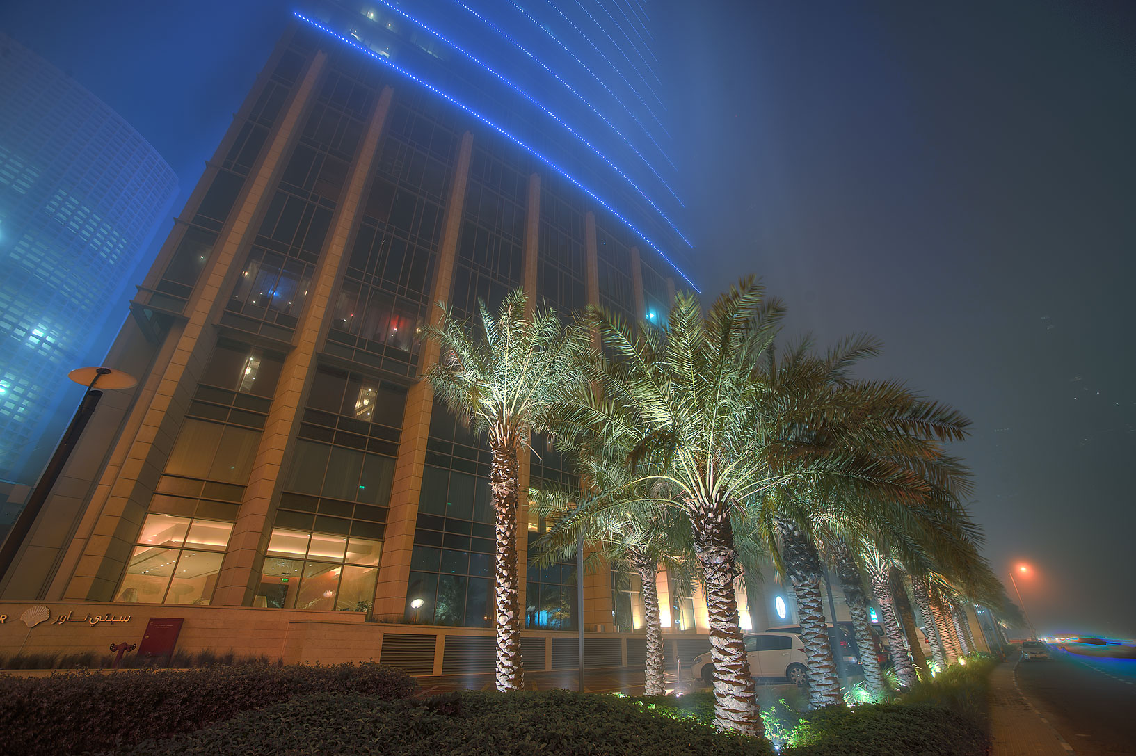 Marriott Hotel in West Bay in fog at morning. Doha, Qatar