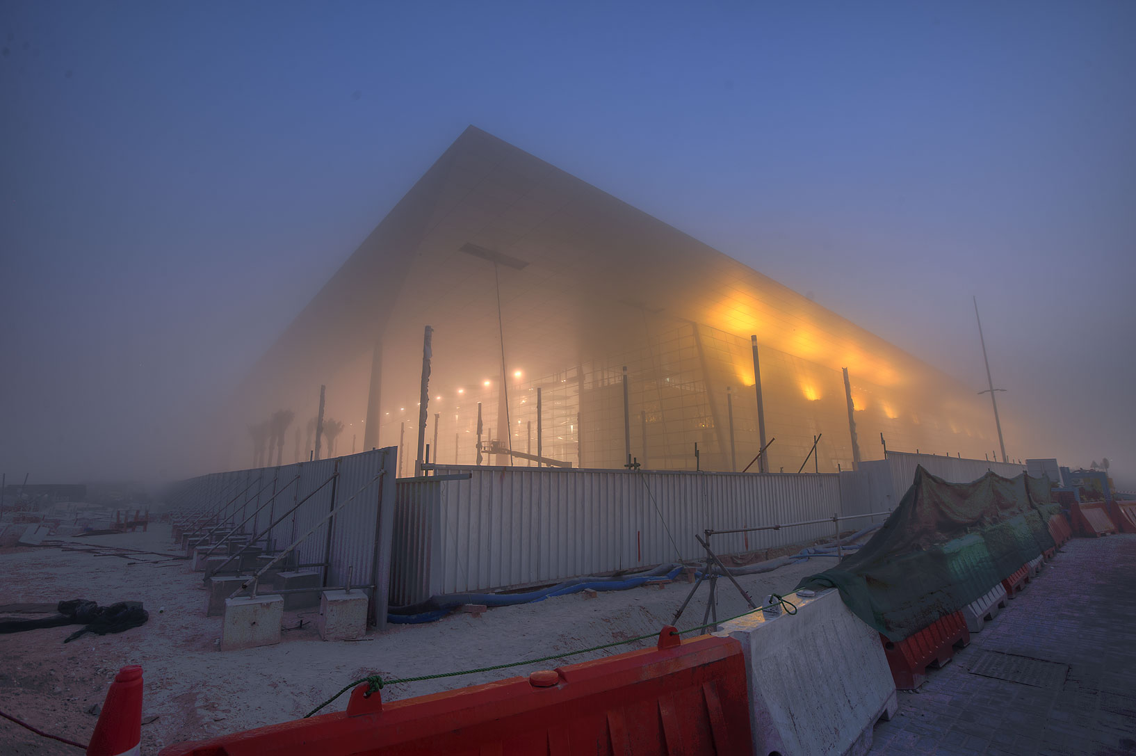 Doha Convention Center (under construction) in West Bay in fog. Doha, Qatar