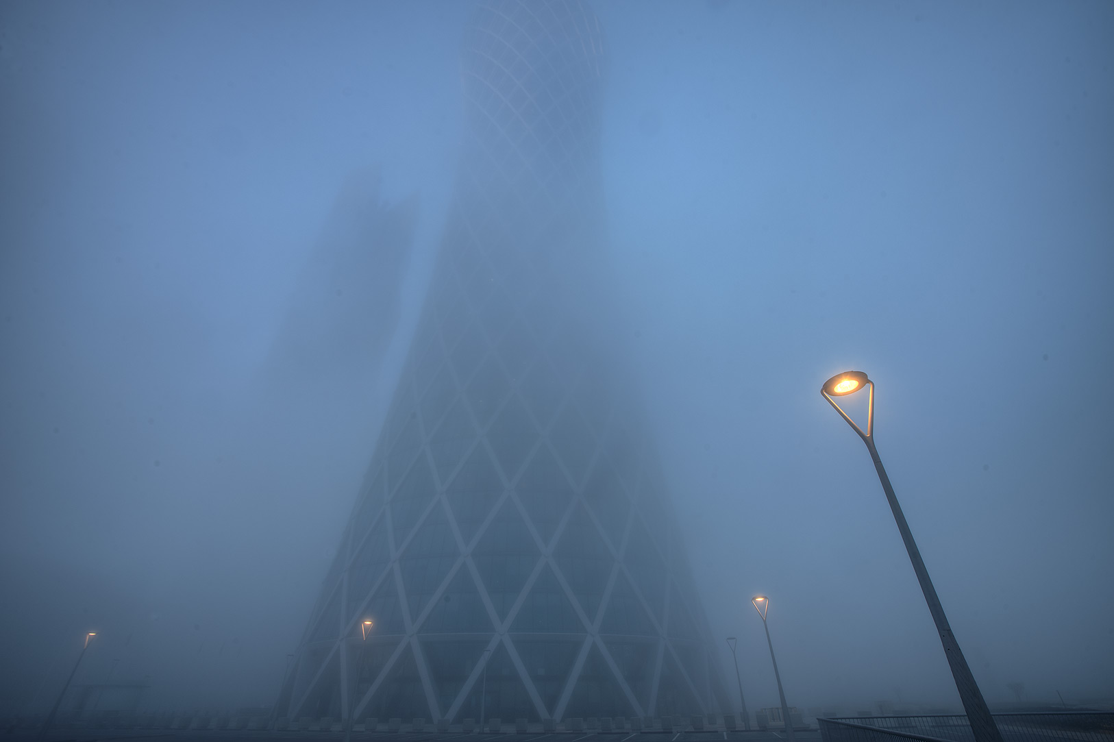 Tornado Tower in West Bay in fog. Doha, Qatar