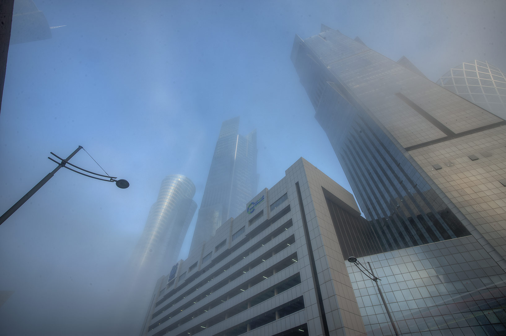 Twin Palm Towers in West Bay in fog, at morning. Doha, Qatar