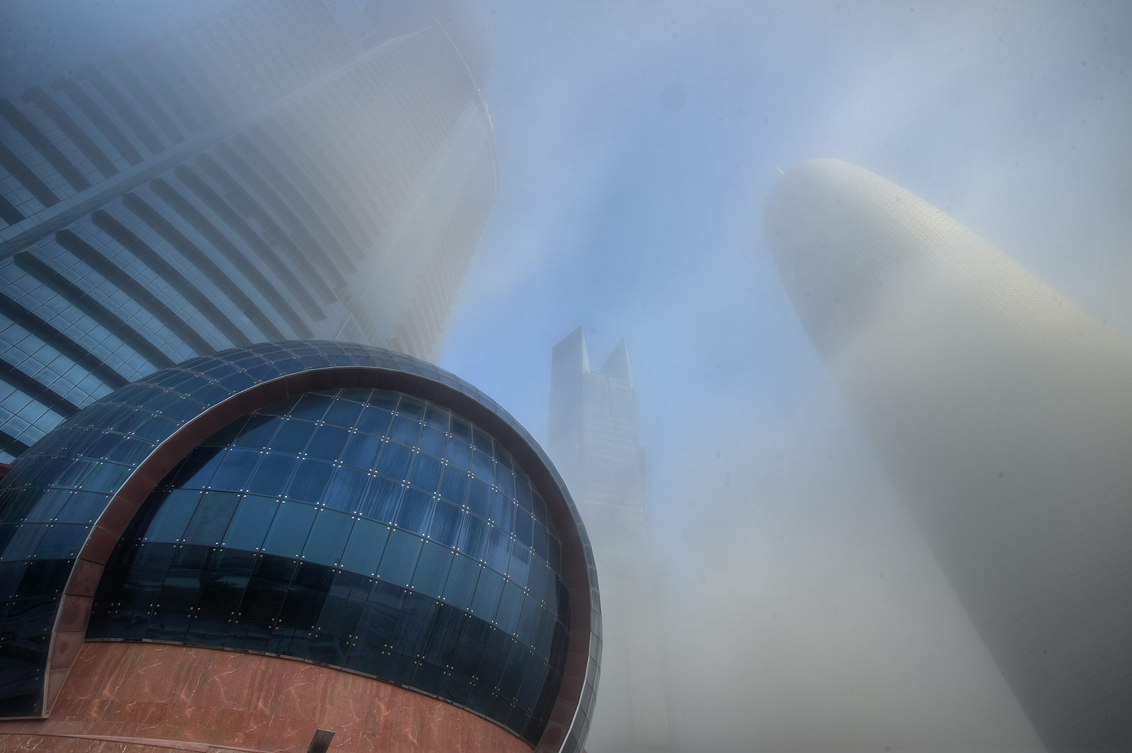 WTC and Burj Qatar Towers in West Bay in fog. Doha, Qatar