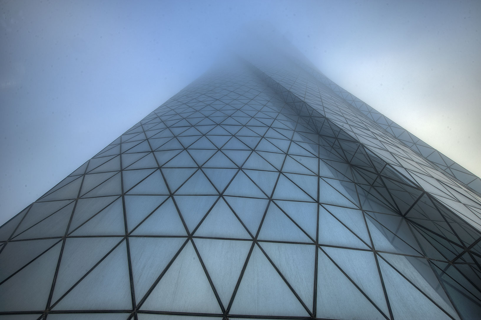 Al Bidda Tower in West Bay in fog, looking up. Doha, Qatar