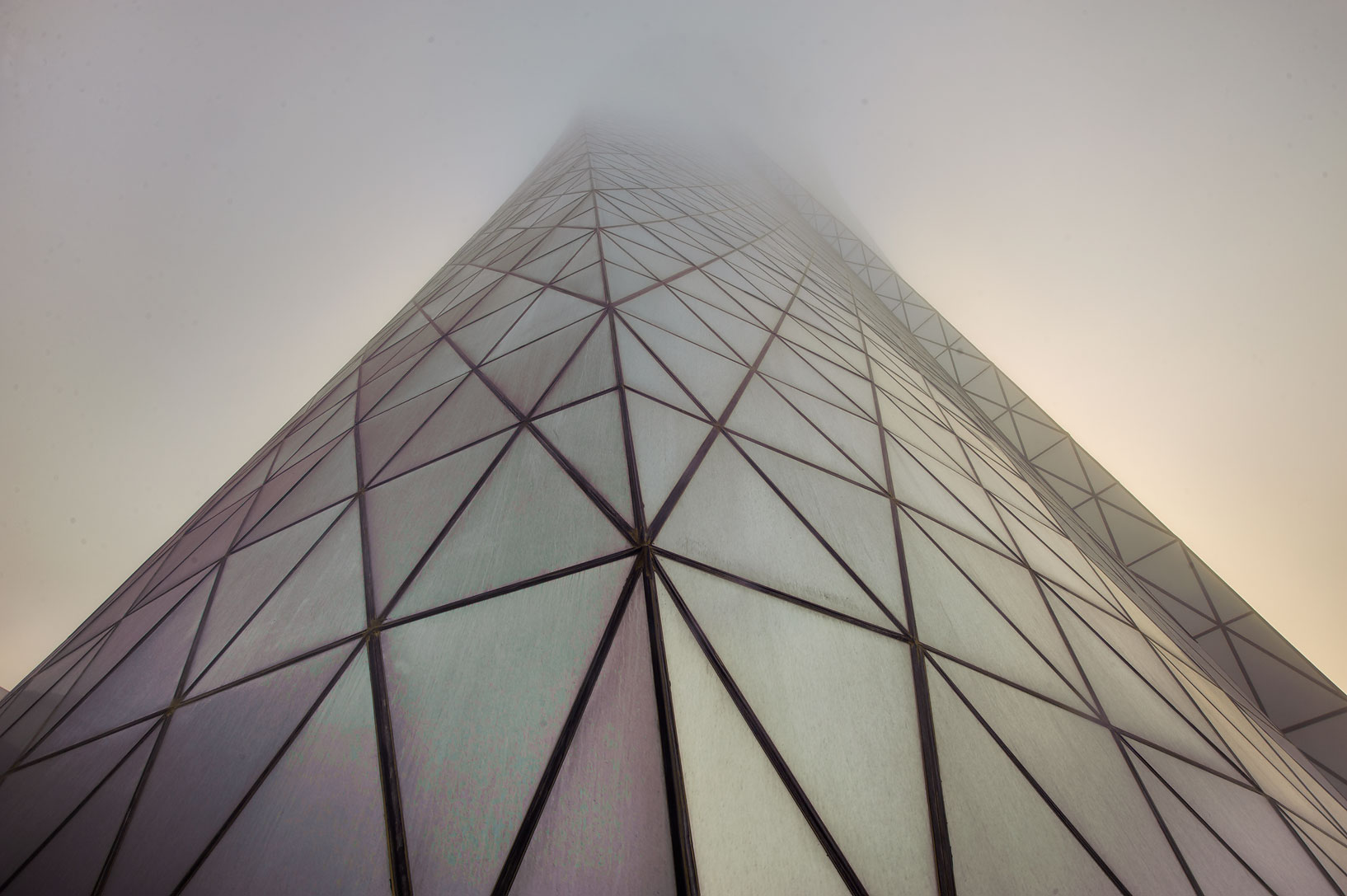 Foot of Al Bidda Tower in West Bay in fog, looking up. Doha, Qatar