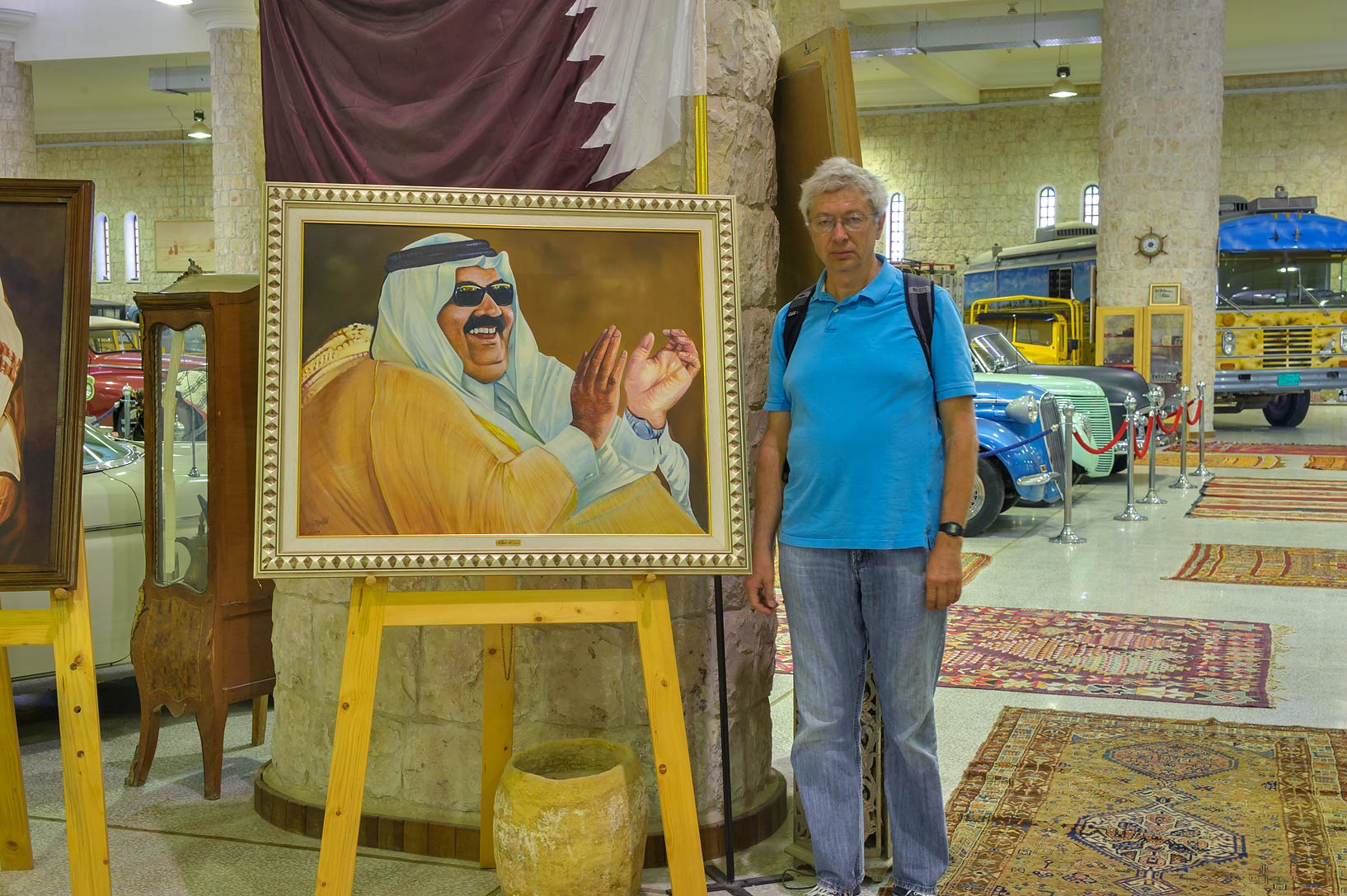 A.S. with a portrait of an emir in Sheikh Faisal...Museum near Al-Shahaniya. Doha, Qatar