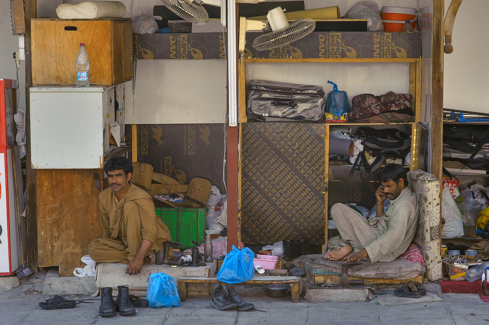 Shoe repair section of Souq Al Ali, near...Gharafa Interchange). Doha, Qatar