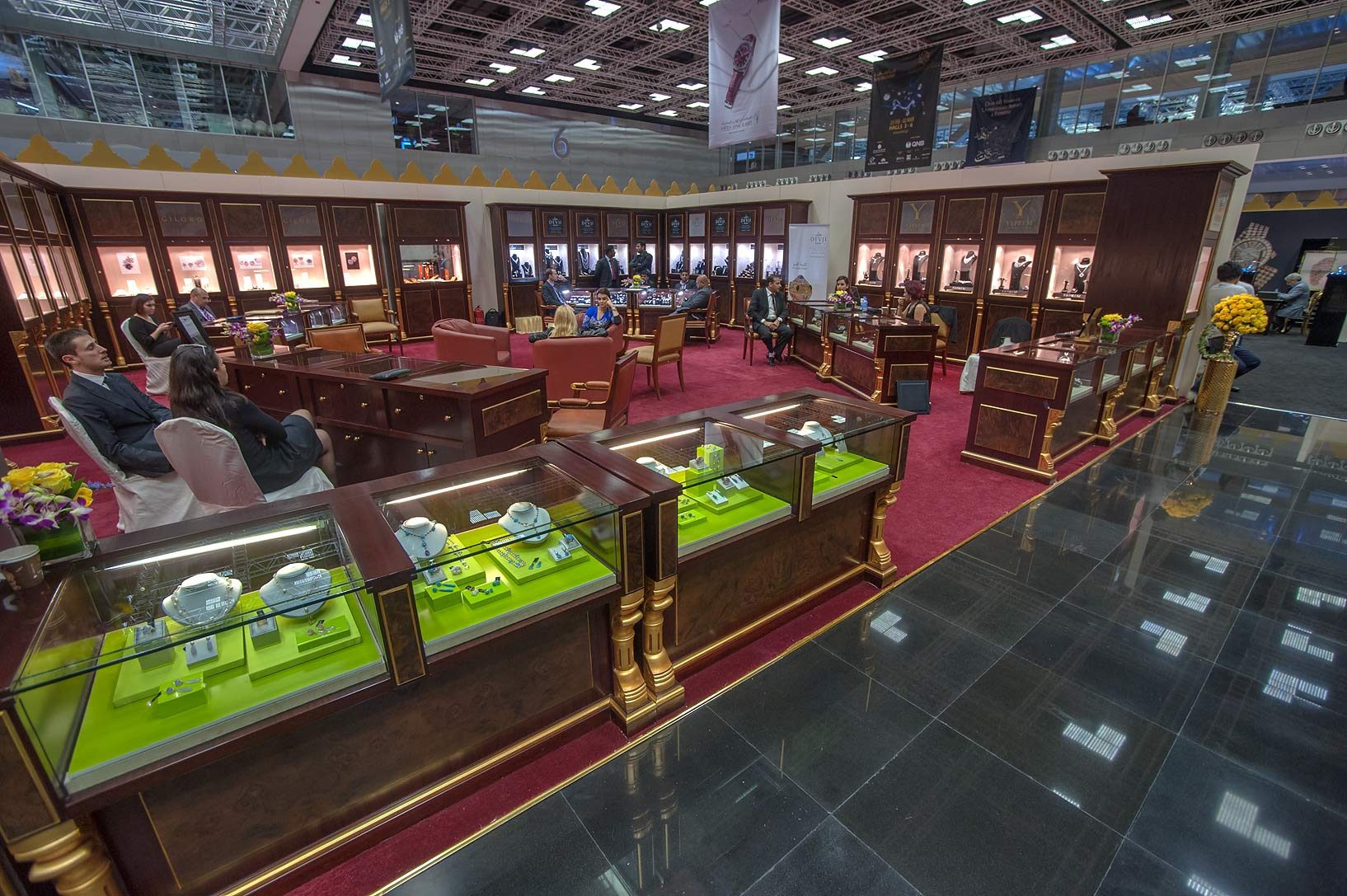 Green stands at jewelry show in National Convention Centre. Doha, Qatar