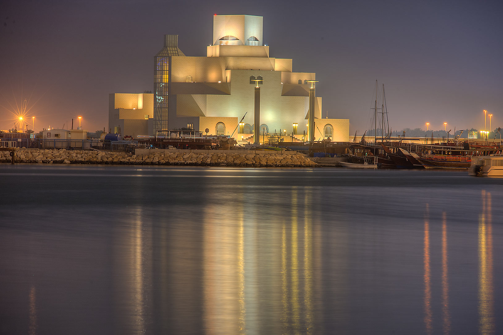 Reflections of Museum of Islamic Art from Corniche promenade. Doha, Qatar