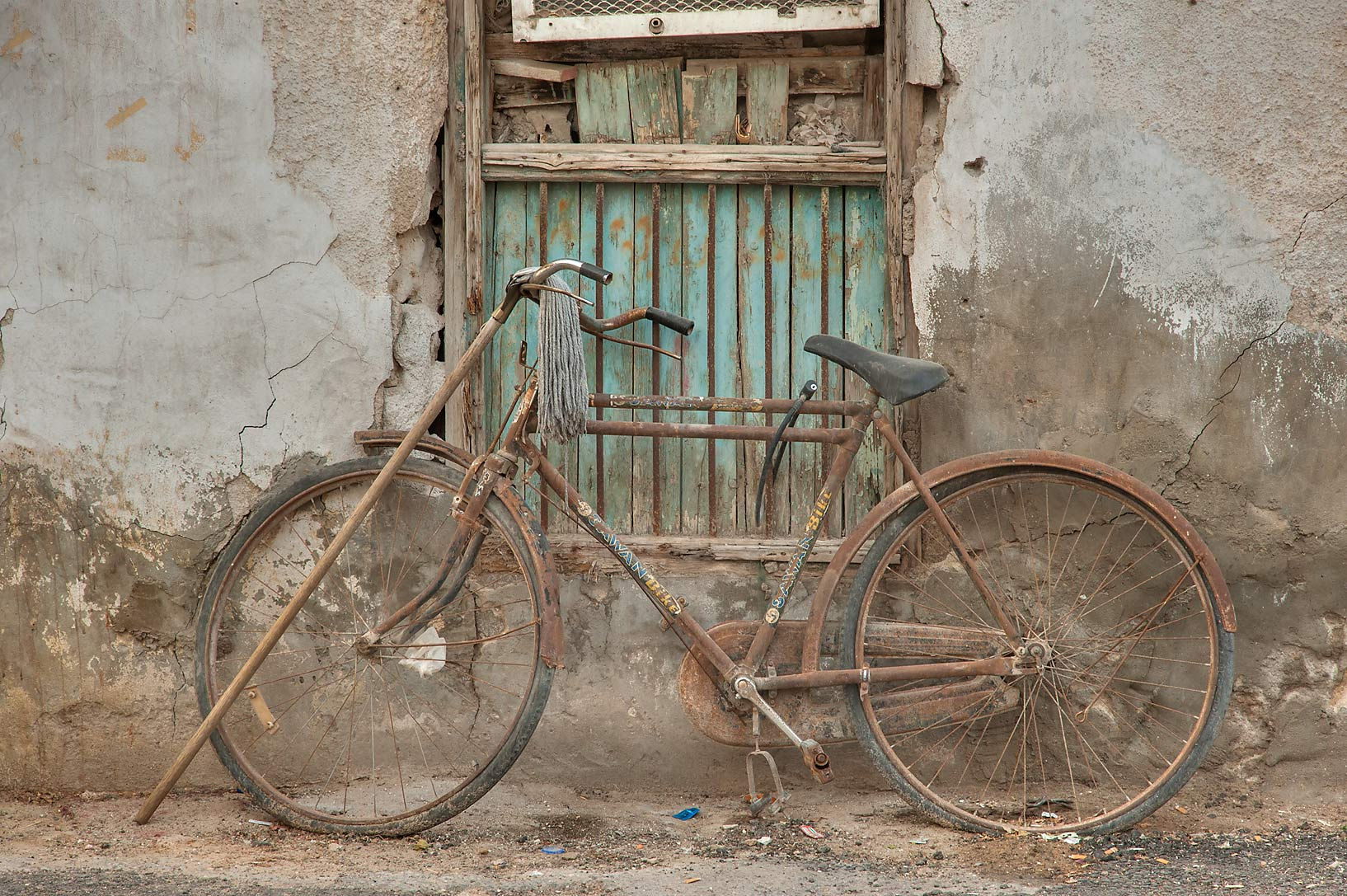 Rusty bicycle on Zurara Bin Amir St. in Al Doha Al Jadeeda area. Doha, Qatar