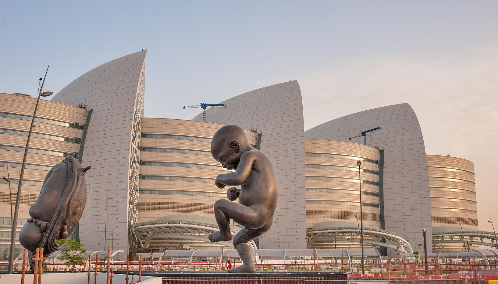 "Miraculous Journey"" sculptures (bronze fetus) by...and Research Center. Doha, Qatar"