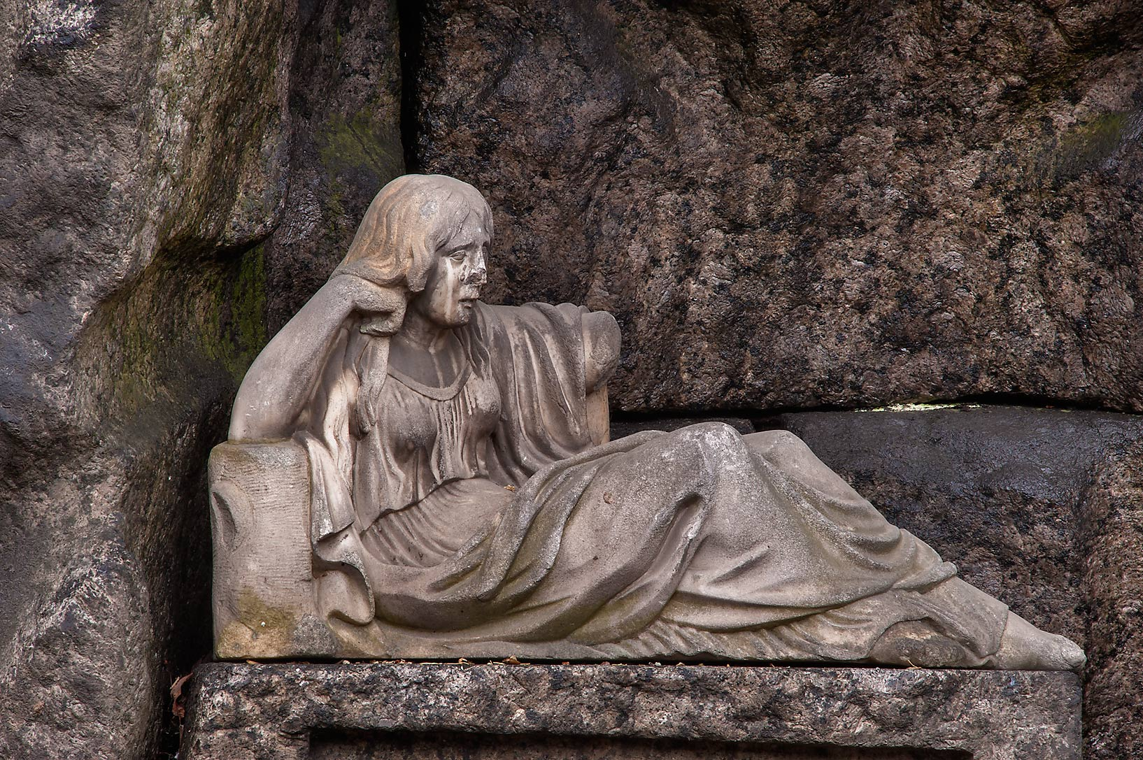 Relaxed woman on a tomb in Necropolis of...Cemetery). St.Petersburg, Russia