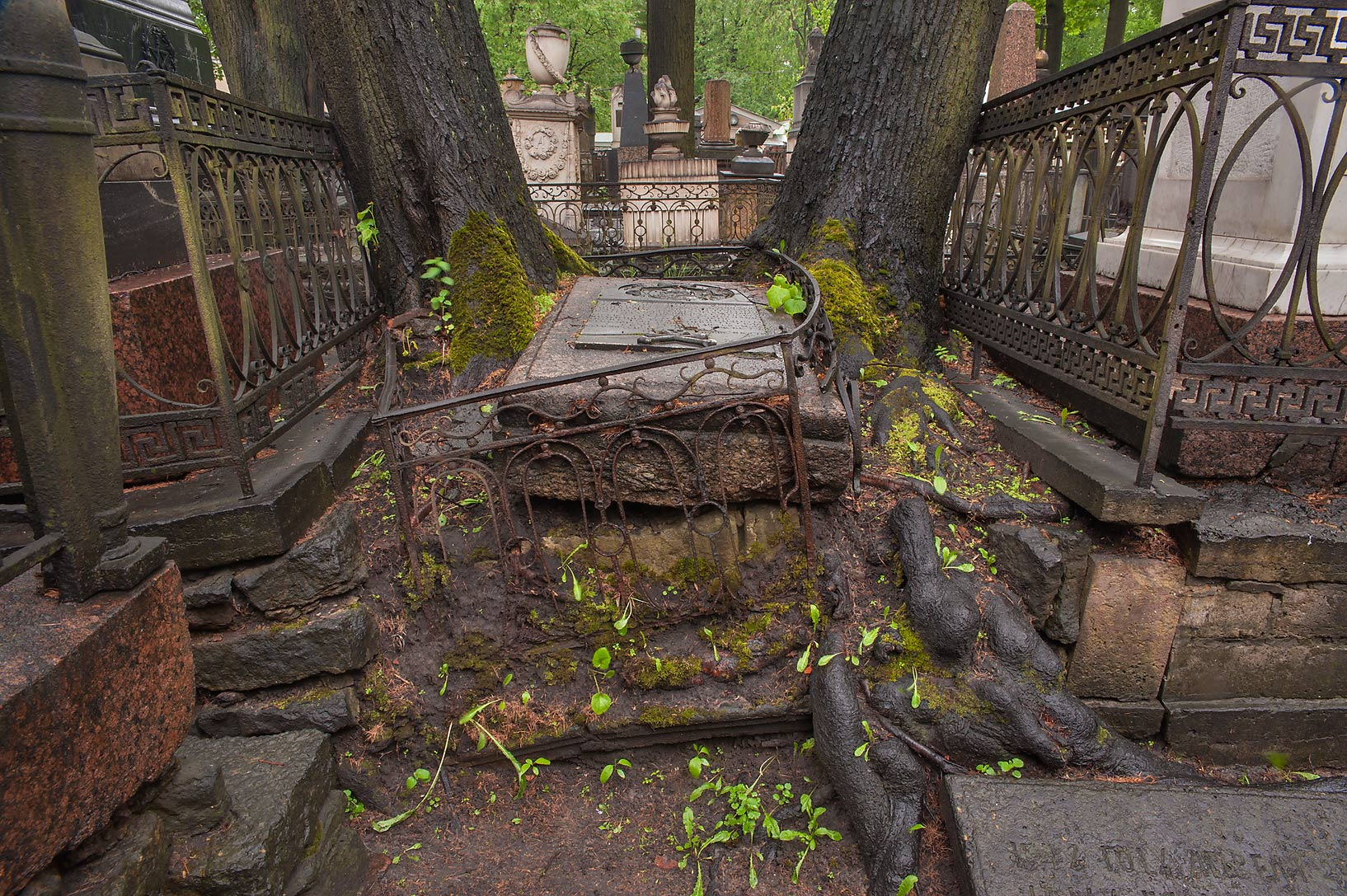Half opened tomb in Necropolis of Alexander...Cemetery). St.Petersburg, Russia