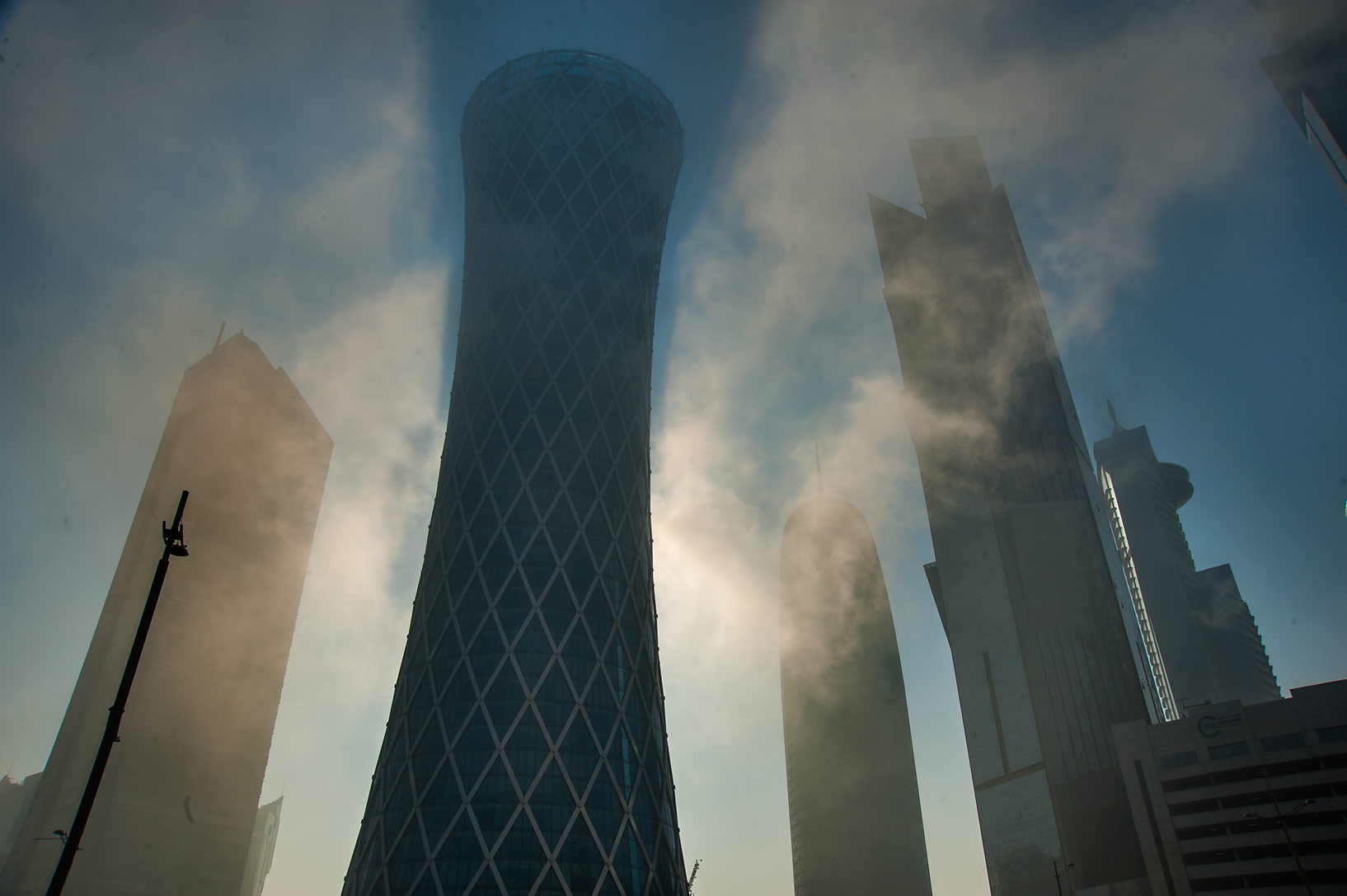 Tornado Tower at Majlis Al Taawon St. in West Bay at foggy morning. Doha, Qatar
