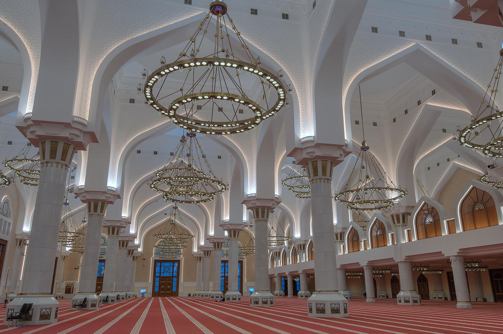 Arches and chandeliers of prayer hall of State...Wahhab Mosque) at morning. Doha, Qatar
