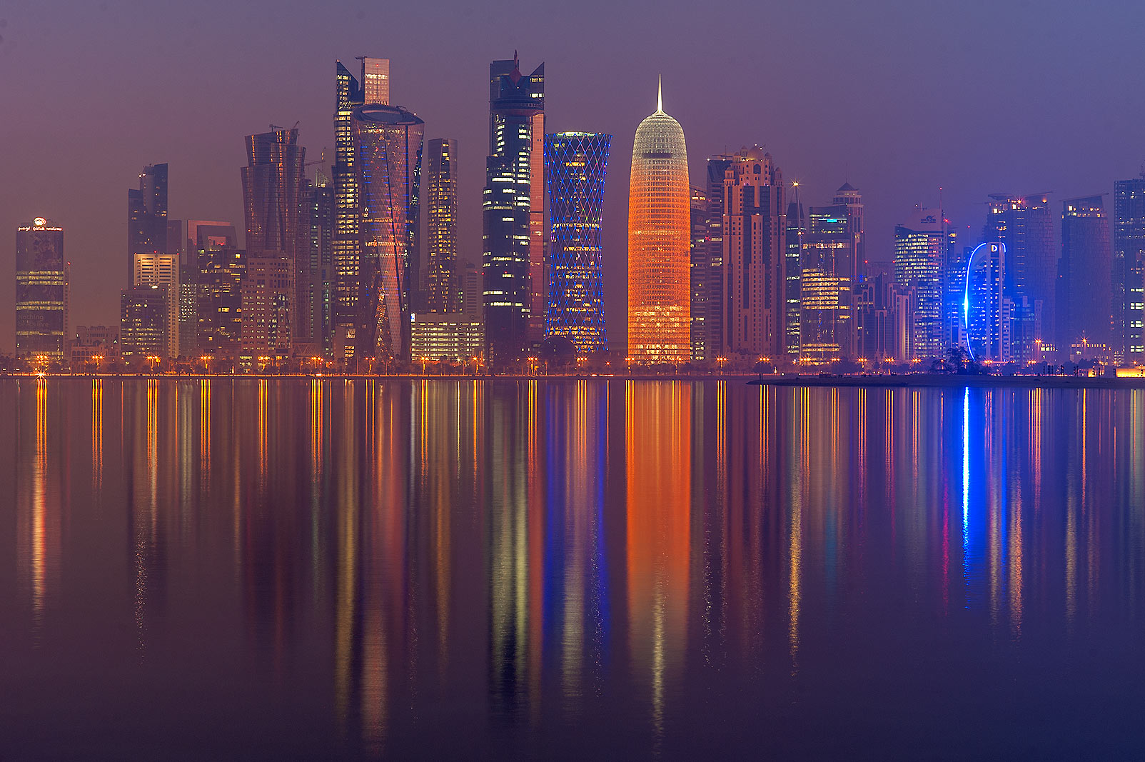 West Bay lights from Corniche promenade at morning dusk. Doha, Qatar