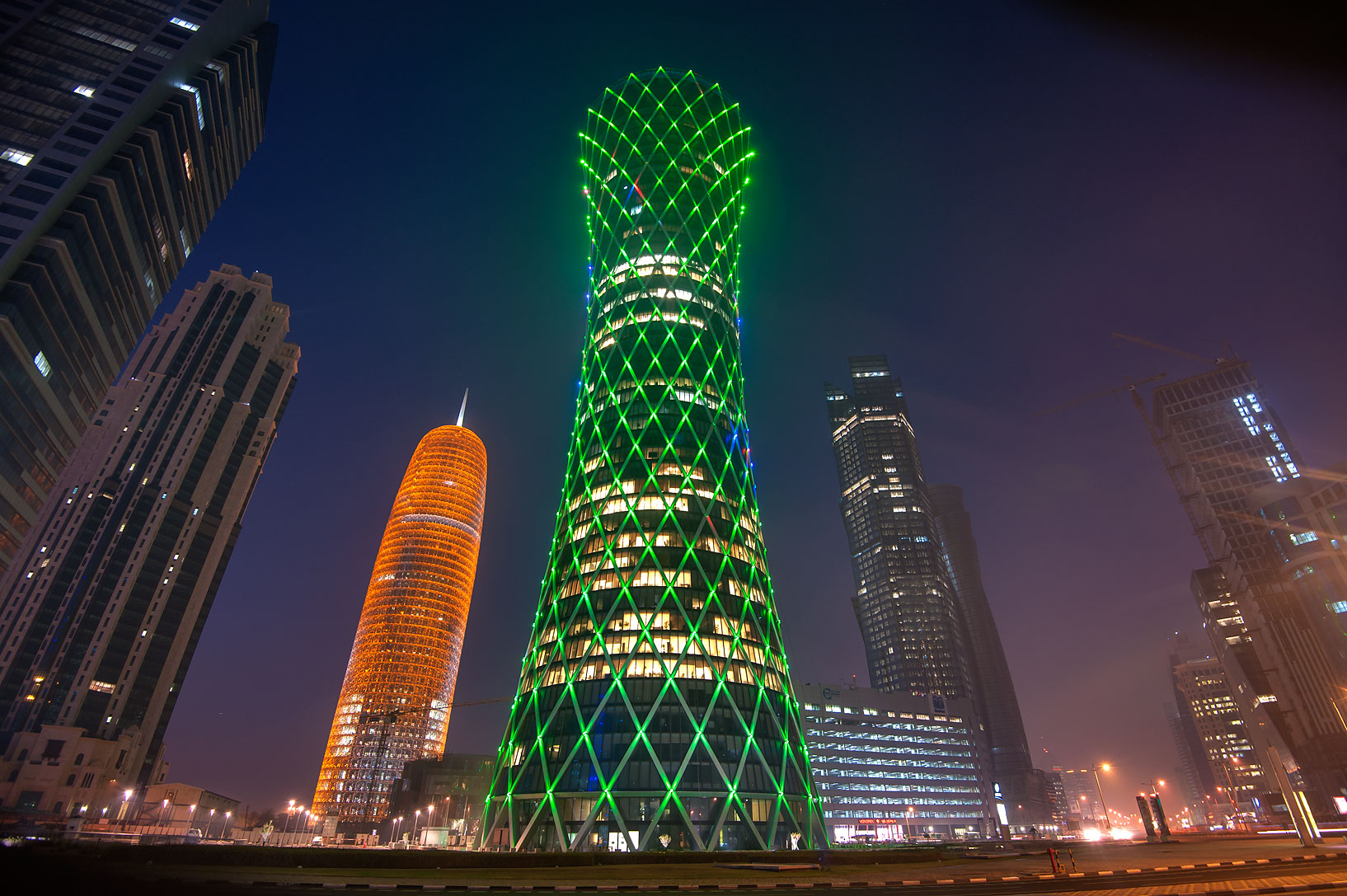 Green lights of Tornado Tower in West Bay. Doha, Qatar