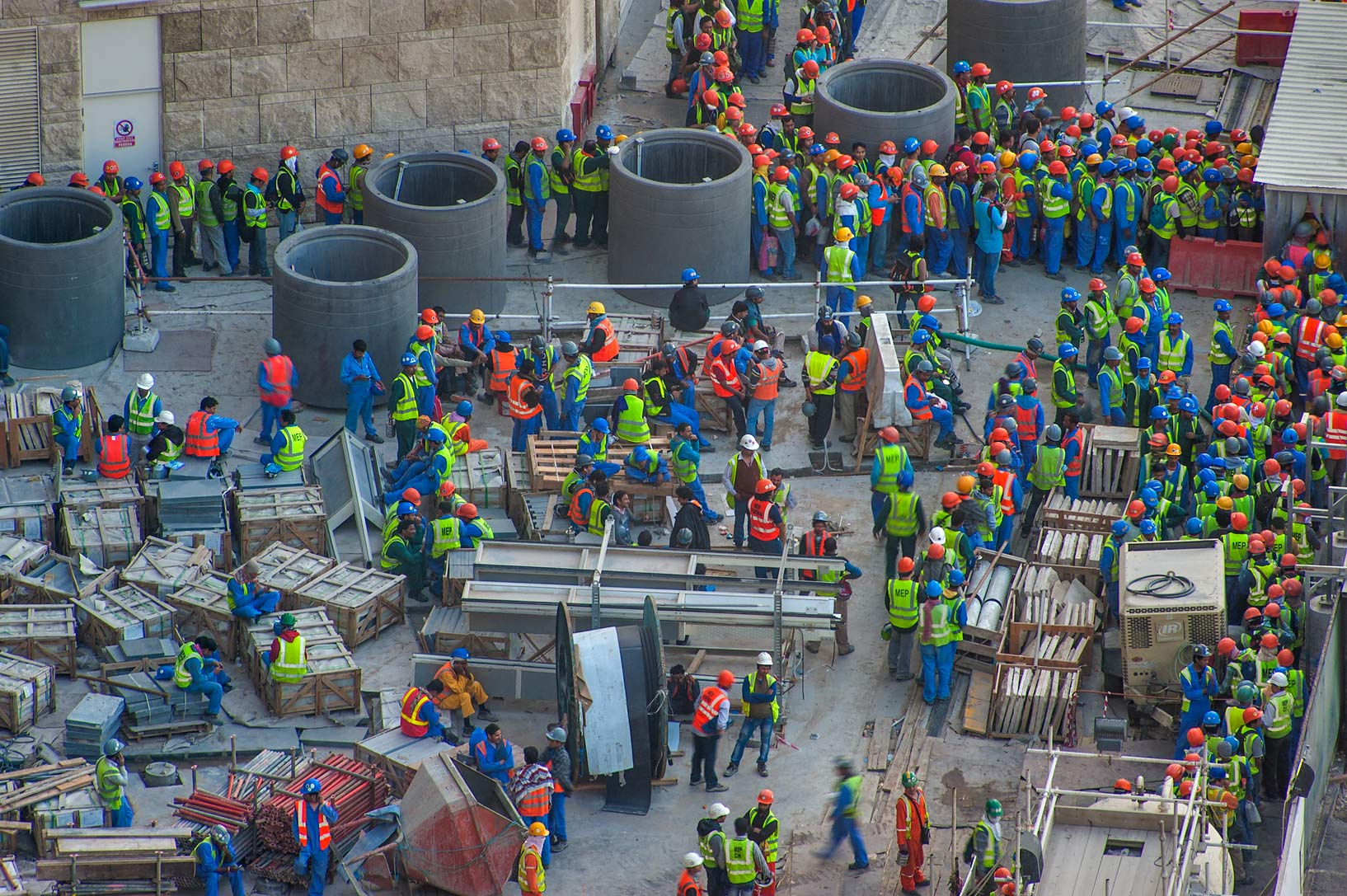 Workers gathering on construction of Qatar...1-2244 of Ezdan Hotel. Doha, Qatar