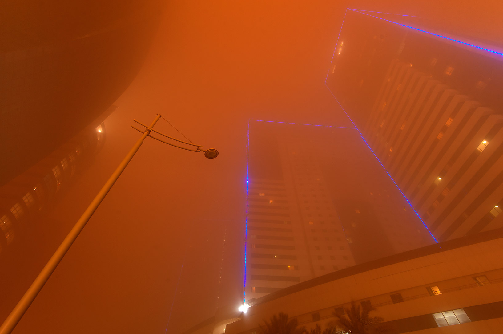 Towers No. 1 and 3 of Ezdan Hotel and Suites in...dust storm at morning. Doha, Qatar