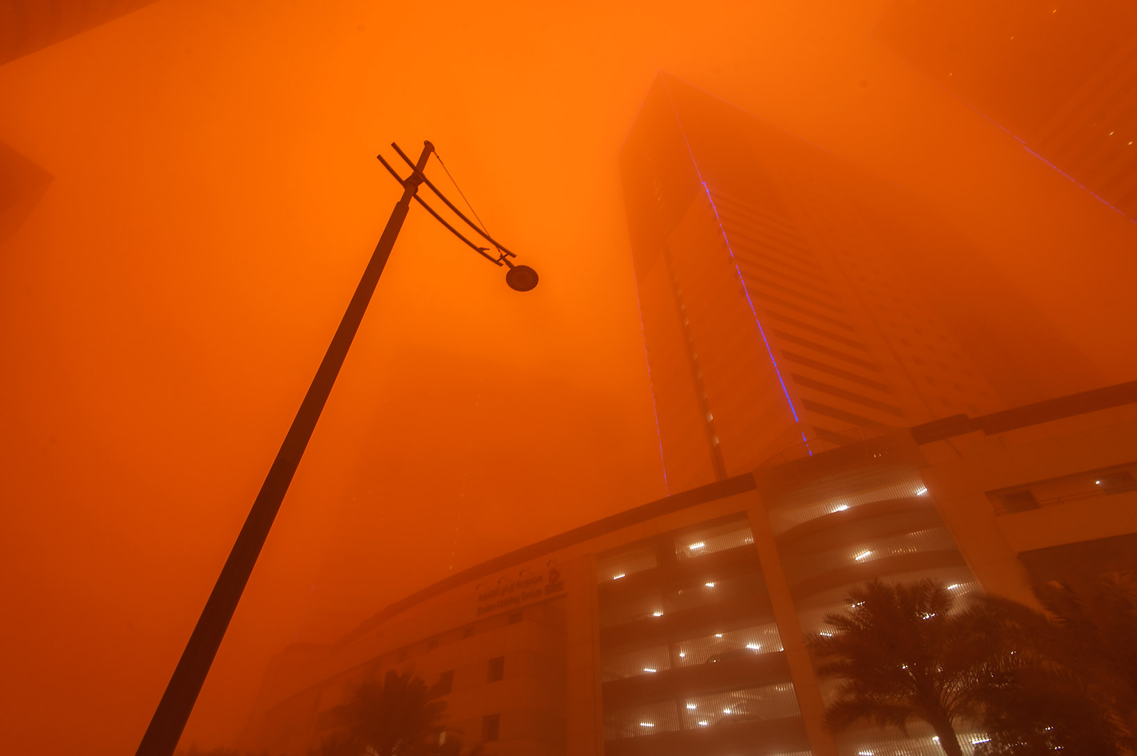 Ezdan Hotel and Suites in West Bay in orange dust. Doha, Qatar