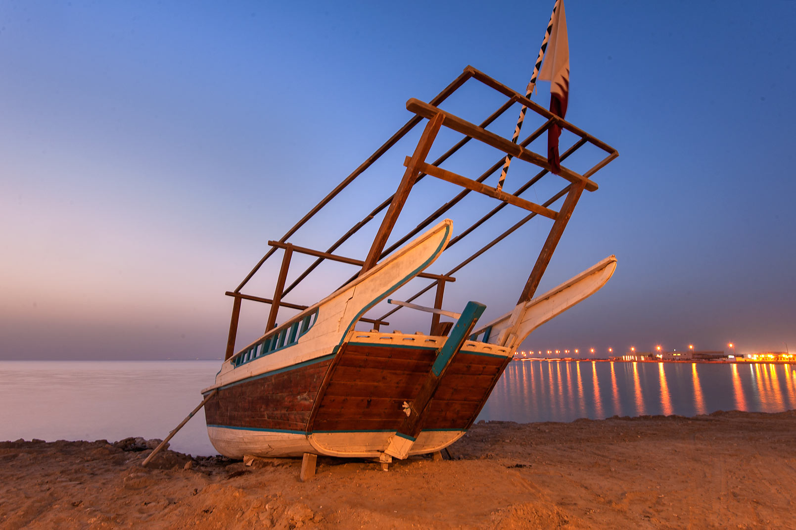 Beached dhow boat in Al Wakra Heritage Village (Souq Waqif in Al Wakrah). Qatar