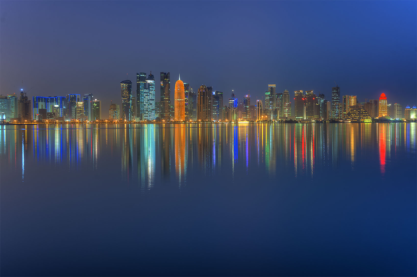 Lights of West Bay from a boat pier at morning dusk. Doha, Qatar