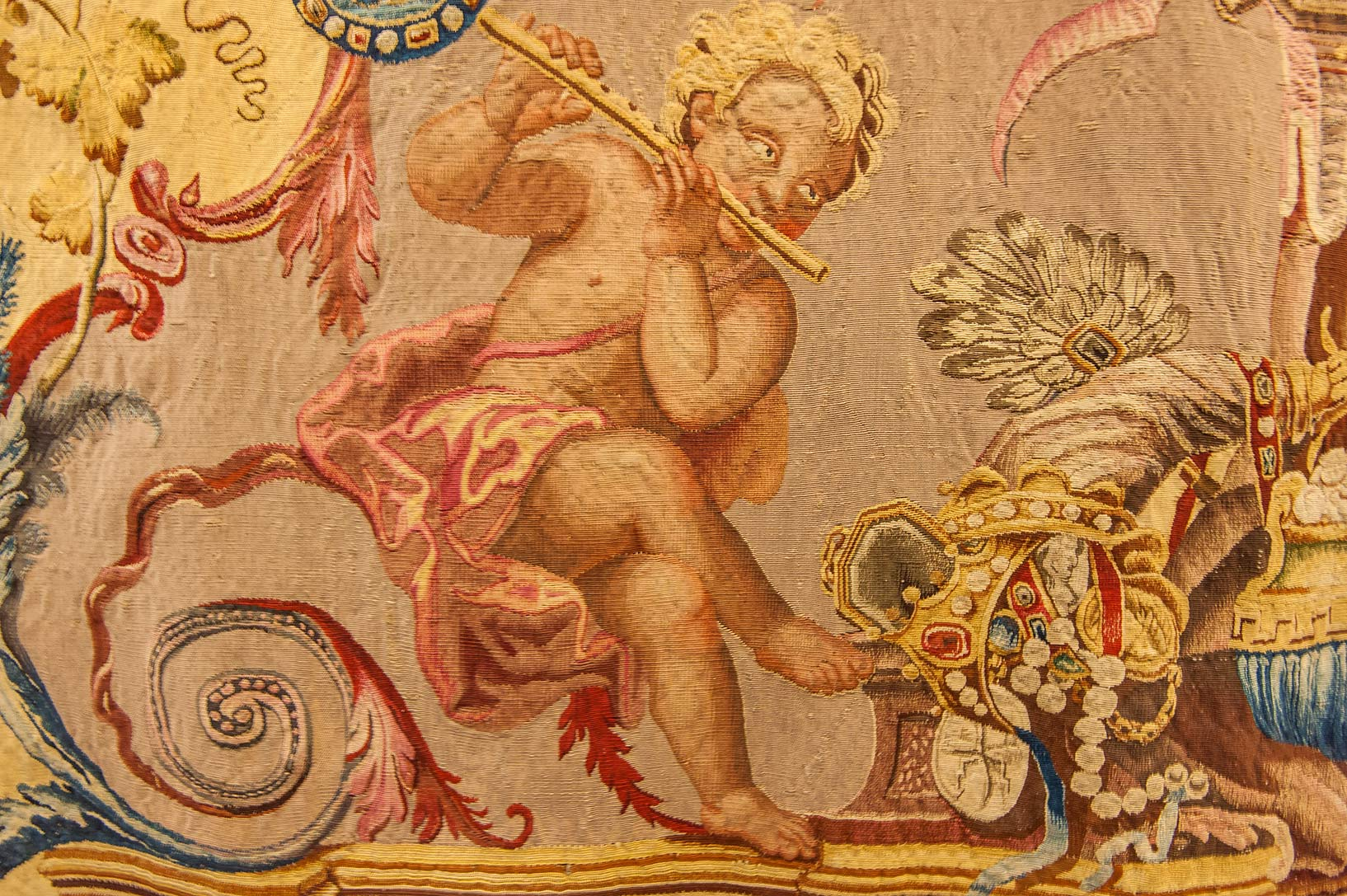 Naked angel on tapestry in Hermitage Museum. St.Petersburg, Russia