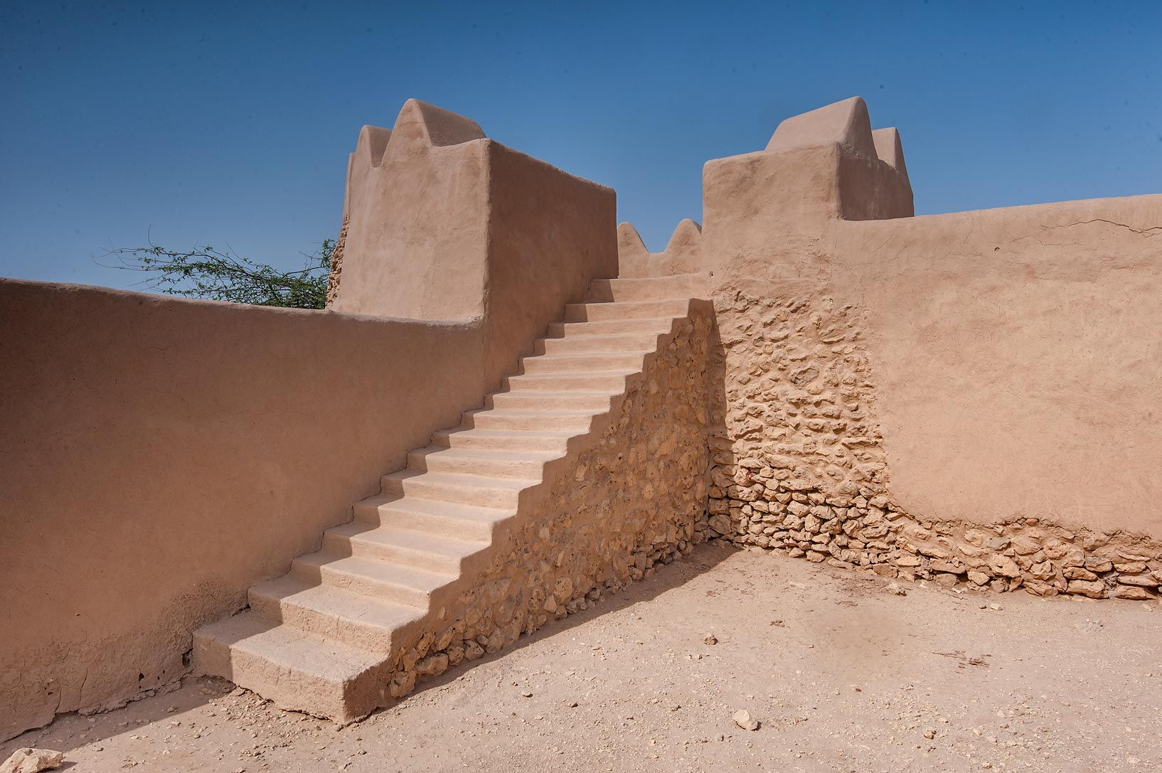 Corner tower with stone stairs of Al-Rekayat Fort in Umm Jasim area. Northern Qatar