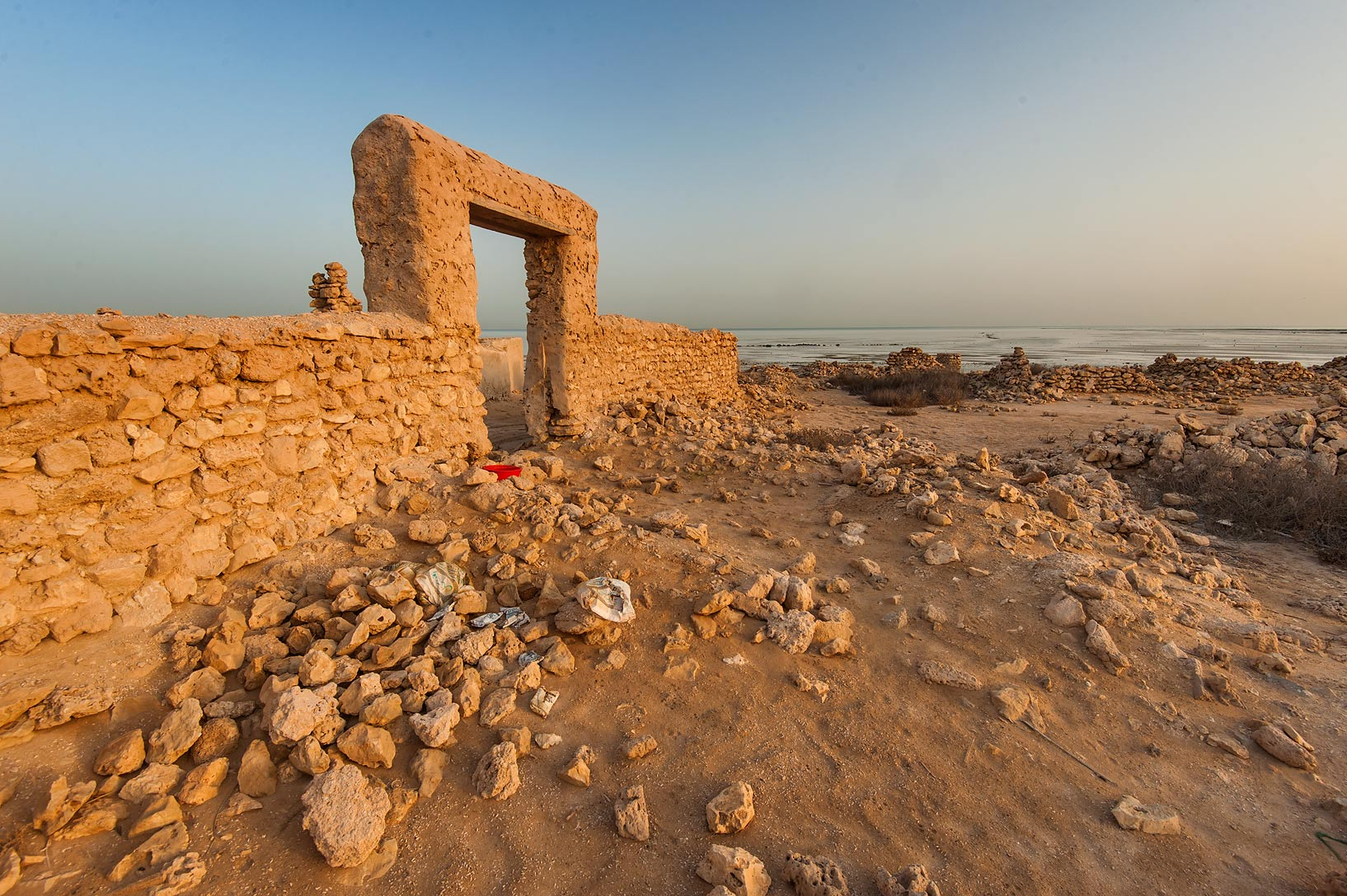Stone ruins at sunrise in a village of Al Jumail (Jumayl) west of Ruwais. Northern Qatar