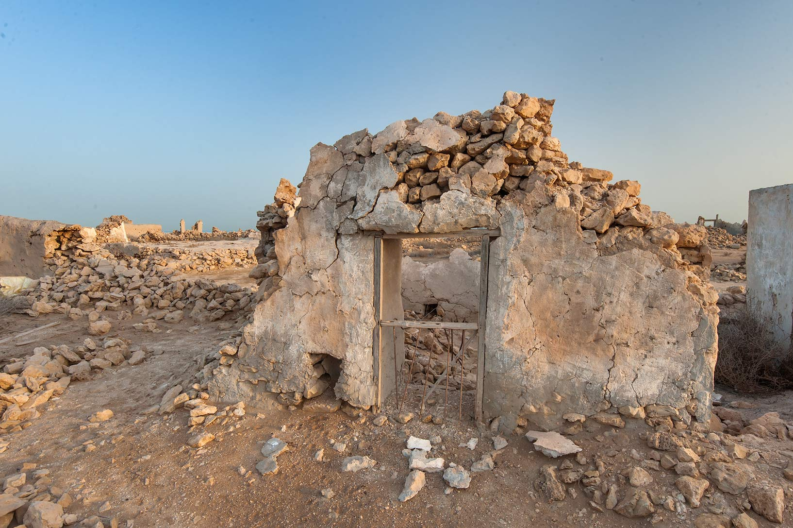 Window in a stone wall in a fishing village of Al...Jumayl) west of Ruwais. Northern Qatar