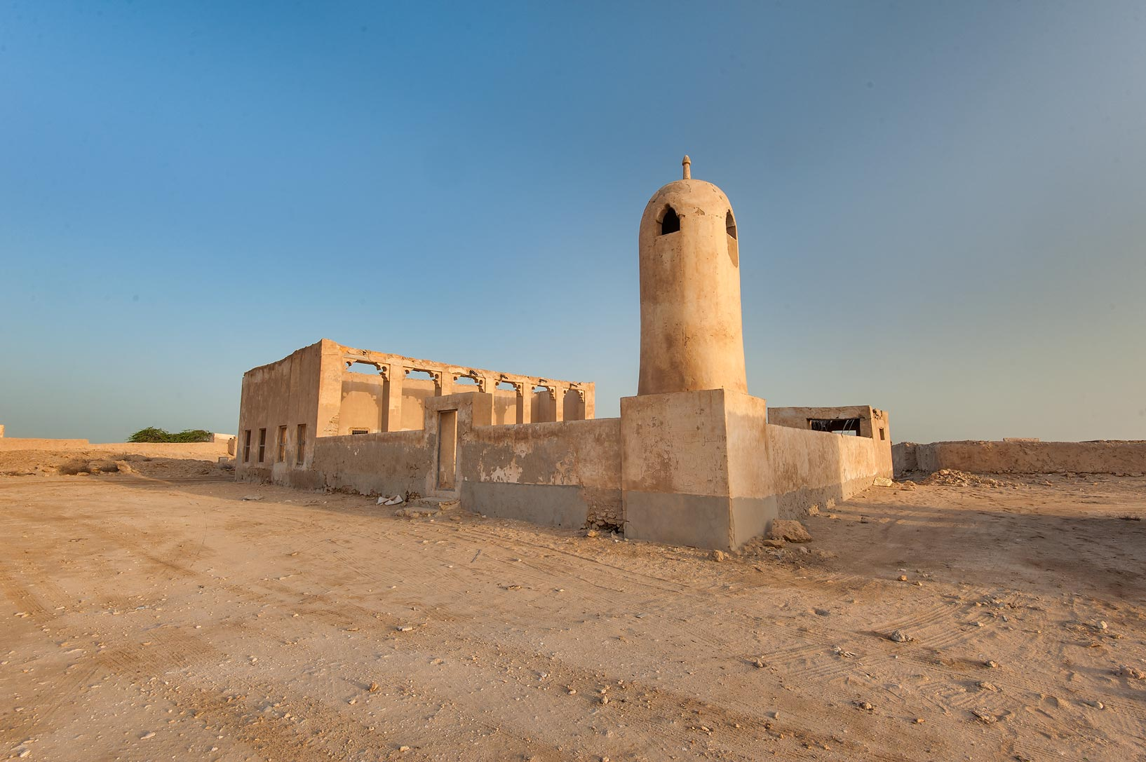 Mosque minaret and traditional colonnade (liwan...Jumayl) west of Ruwais. Northern Qatar