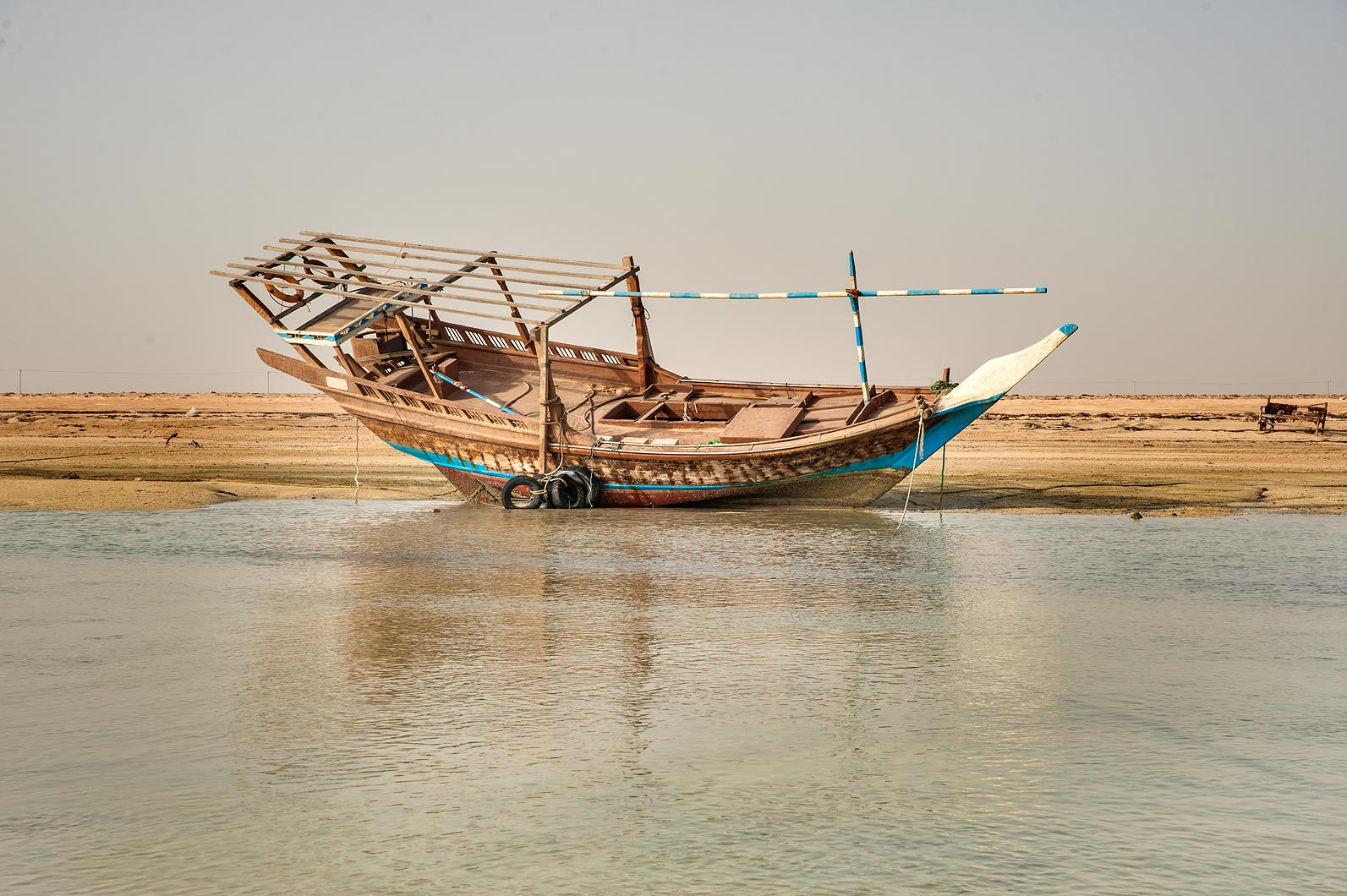Traditional fishing boat dhow on a beach in Al...on northern coast (Al Shamal). Qatar
