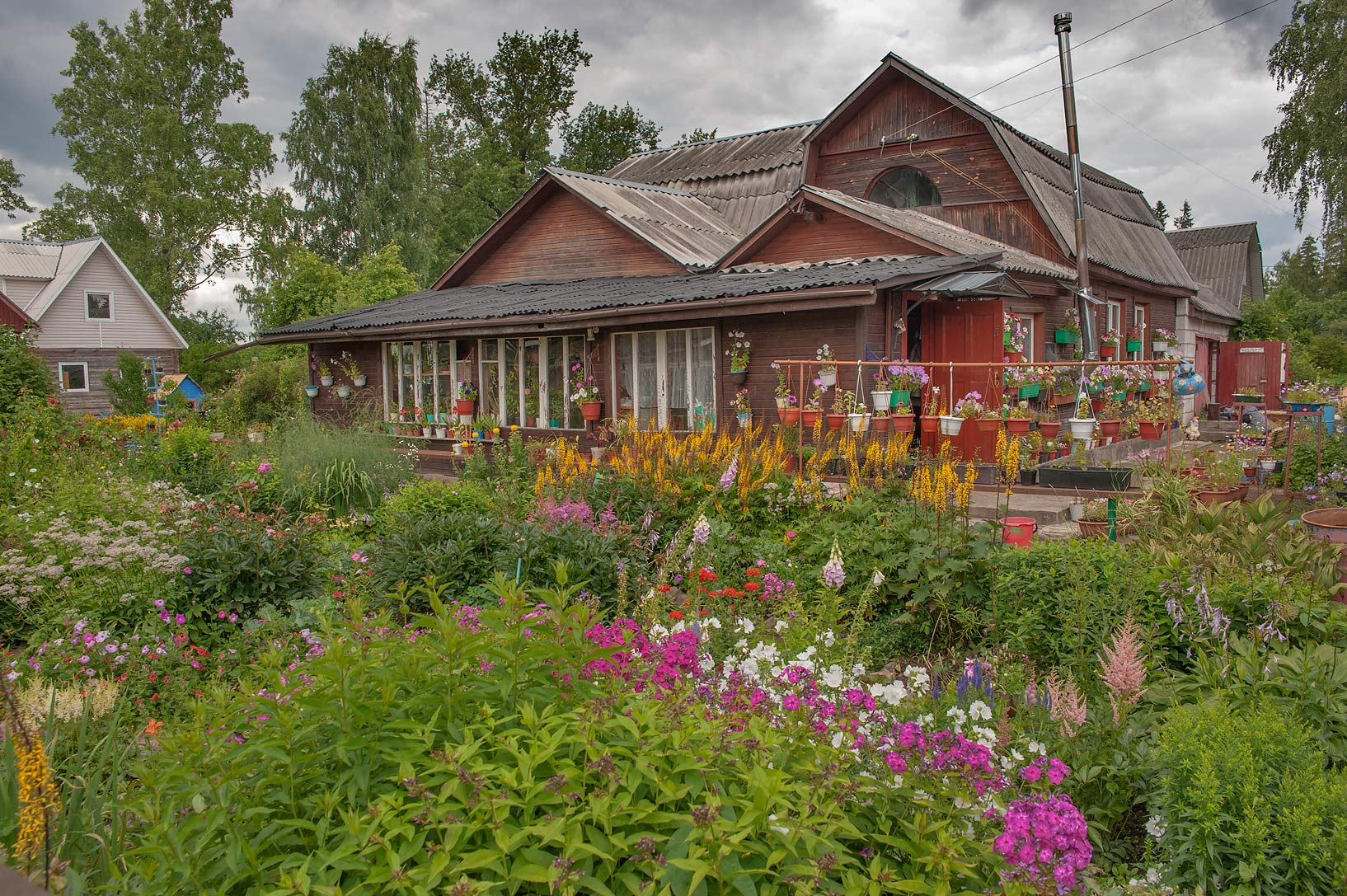 Summer house with flowers on Krasnaya St.. Siverskaya south from St.Petersburg, Russia