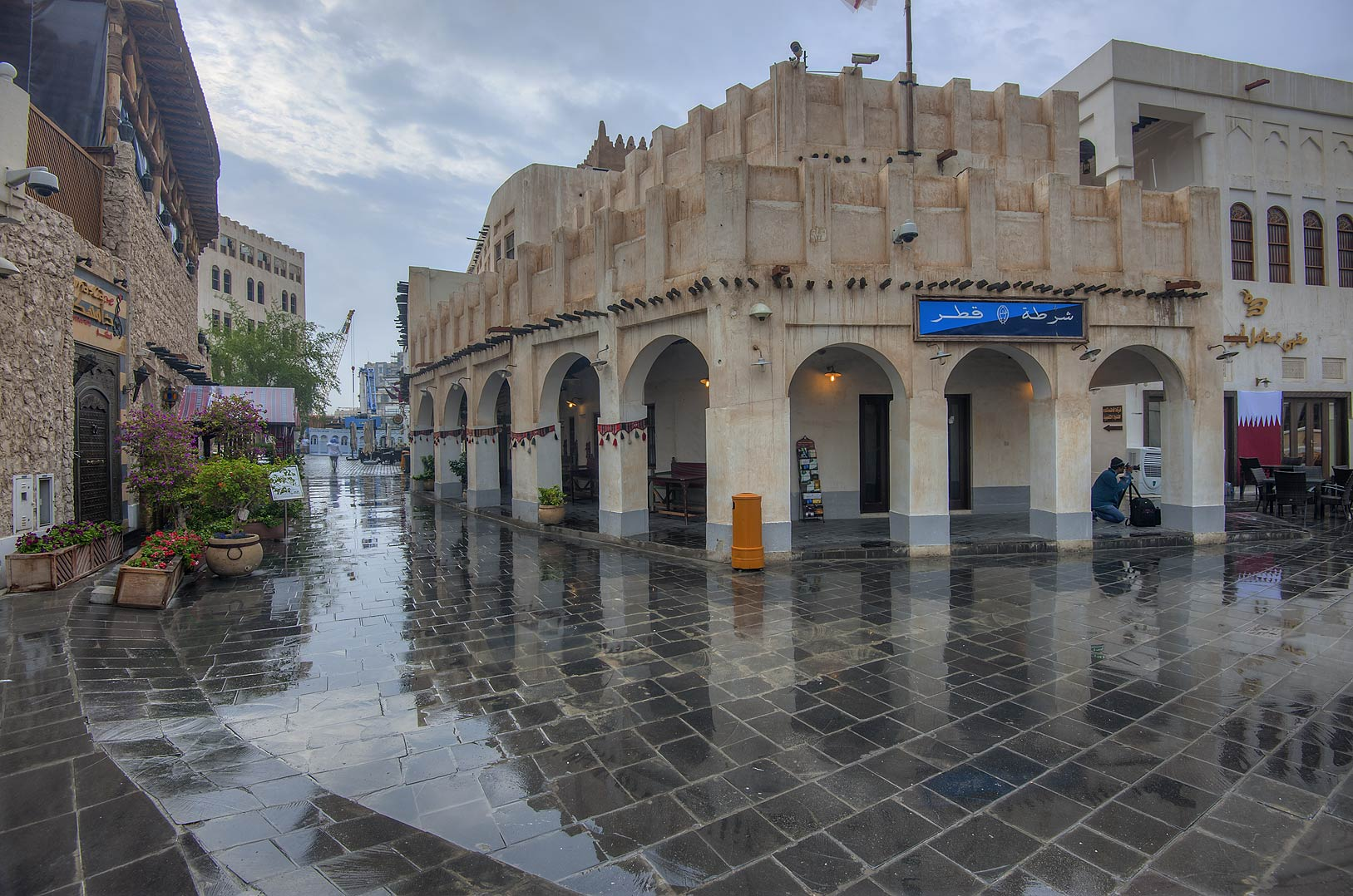 Arched gallery in Souq Waqif market at rain. Doha, Qatar