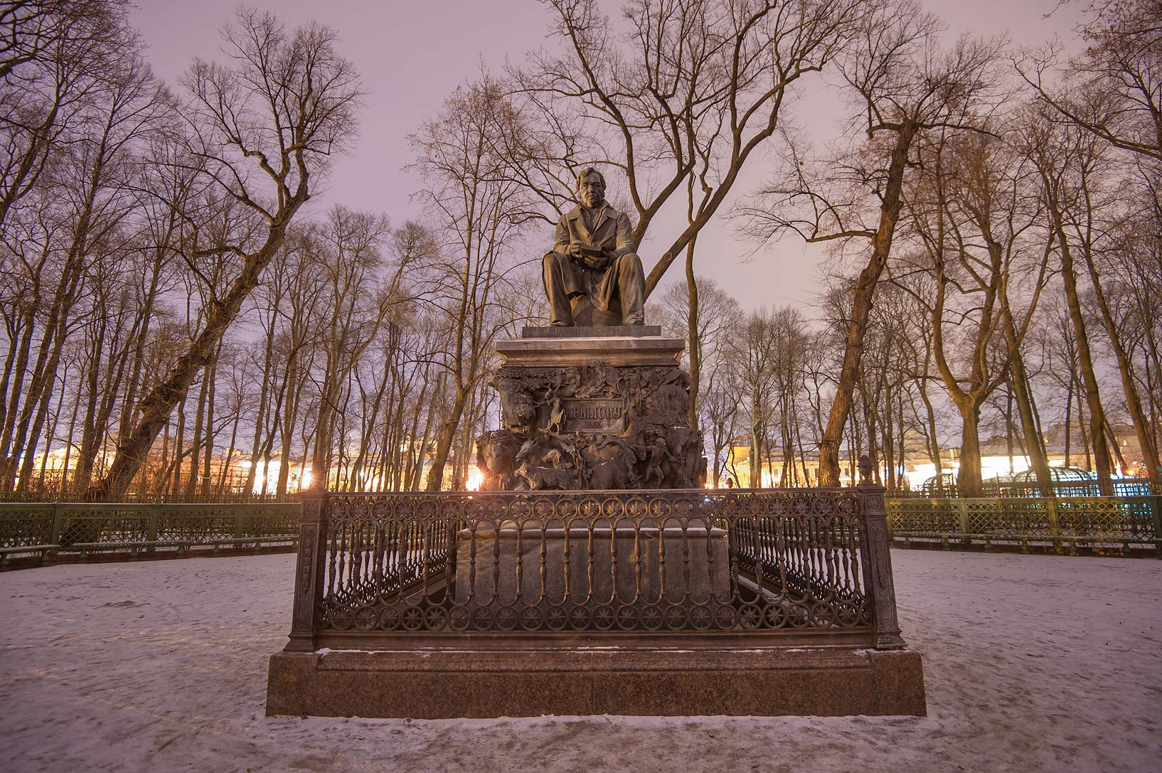 Monument of Russian fabulist Ivan Krylov in Letny...at evening. St.Petersburg, Russia