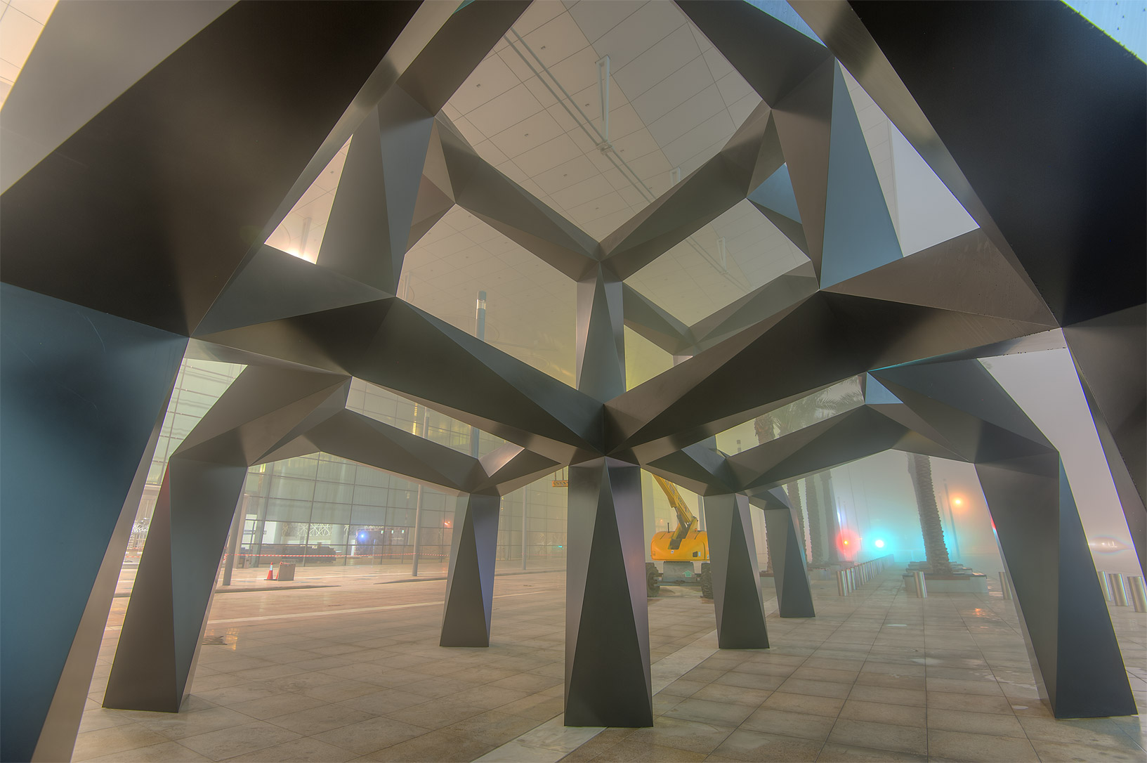 Sculpture Smoke (grid, like skeleton of a cloud...mall in West Bay in fog. Doha, Qatar