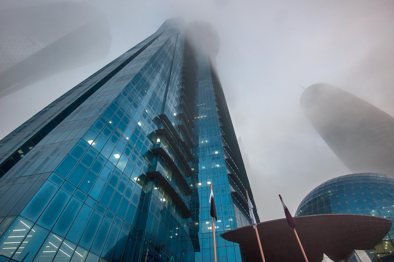 TWC Tower near Corniche in West Bay in fog. Doha, Qatar