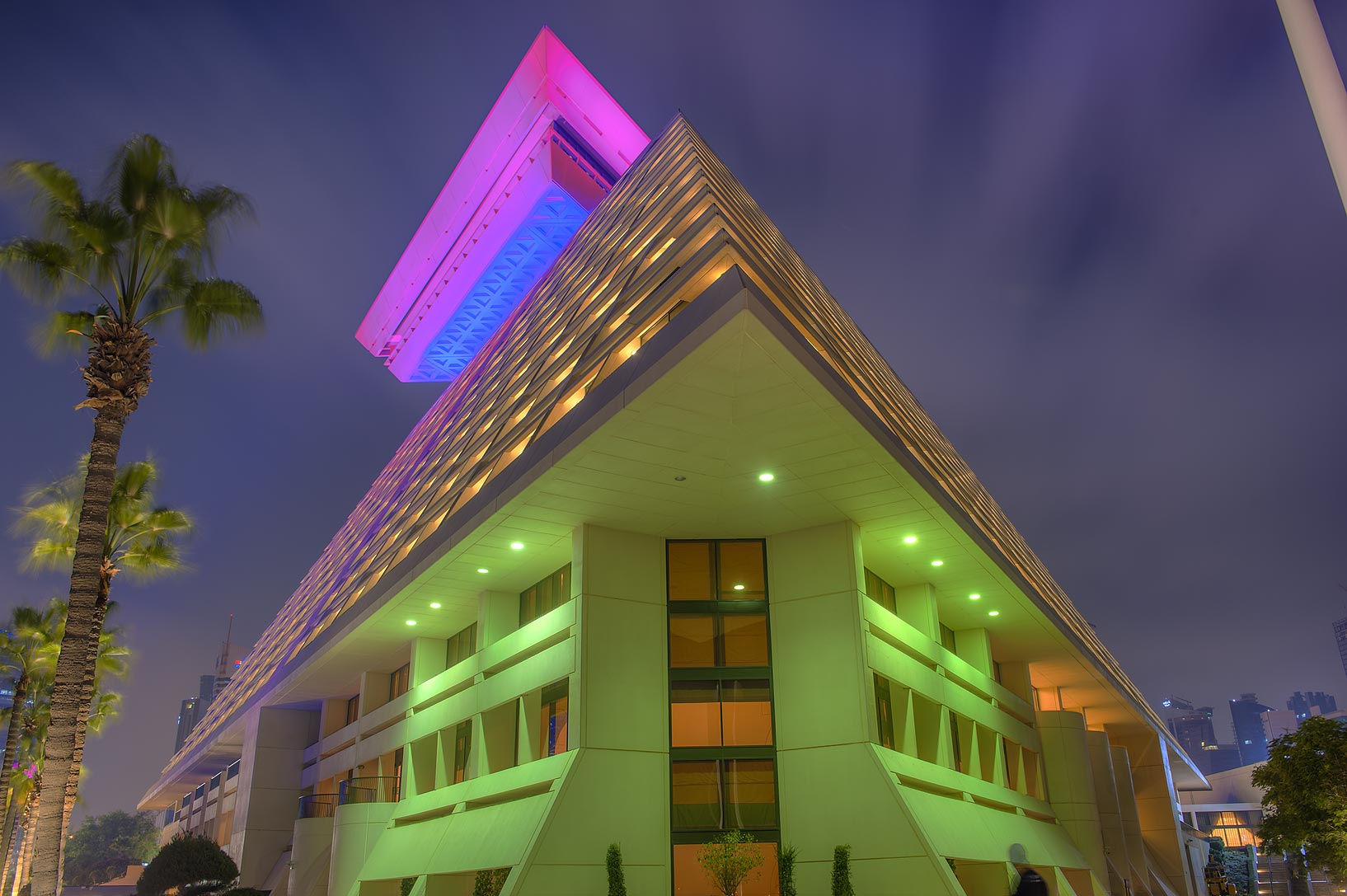 Illuminated corner of Sheraton Hotel at evening. Doha, Qatar