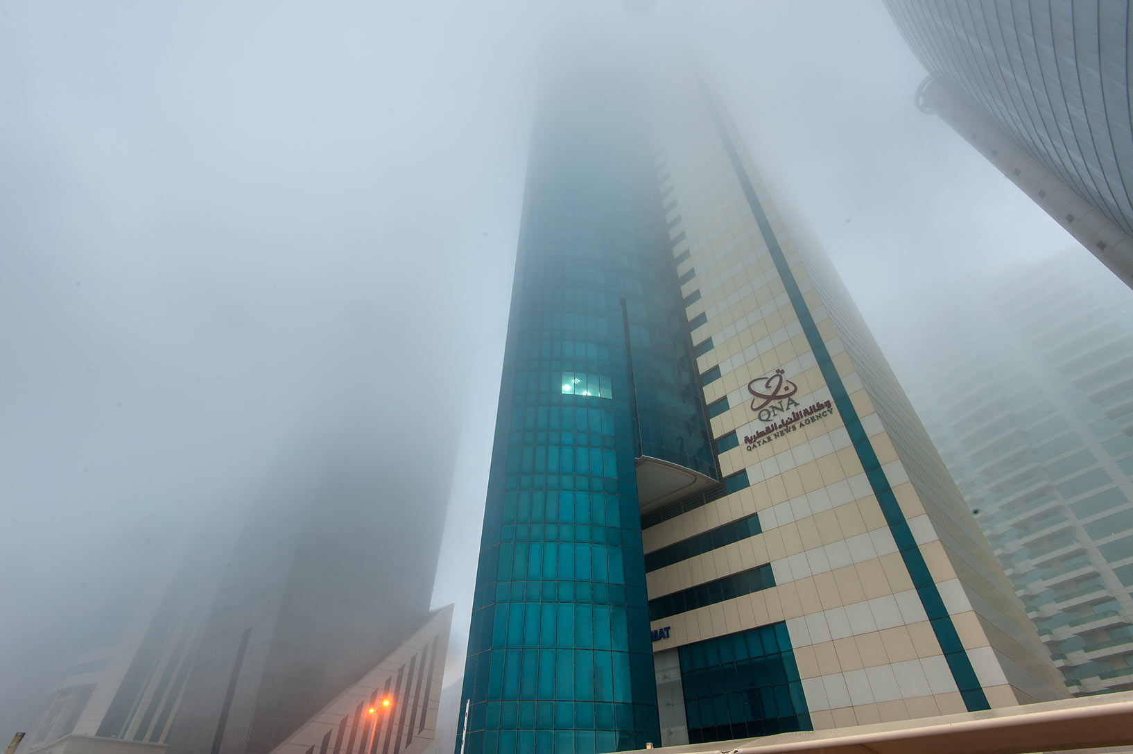Qatar News Agency Tower (QNA) in West Bay in fog. Doha, Qatar