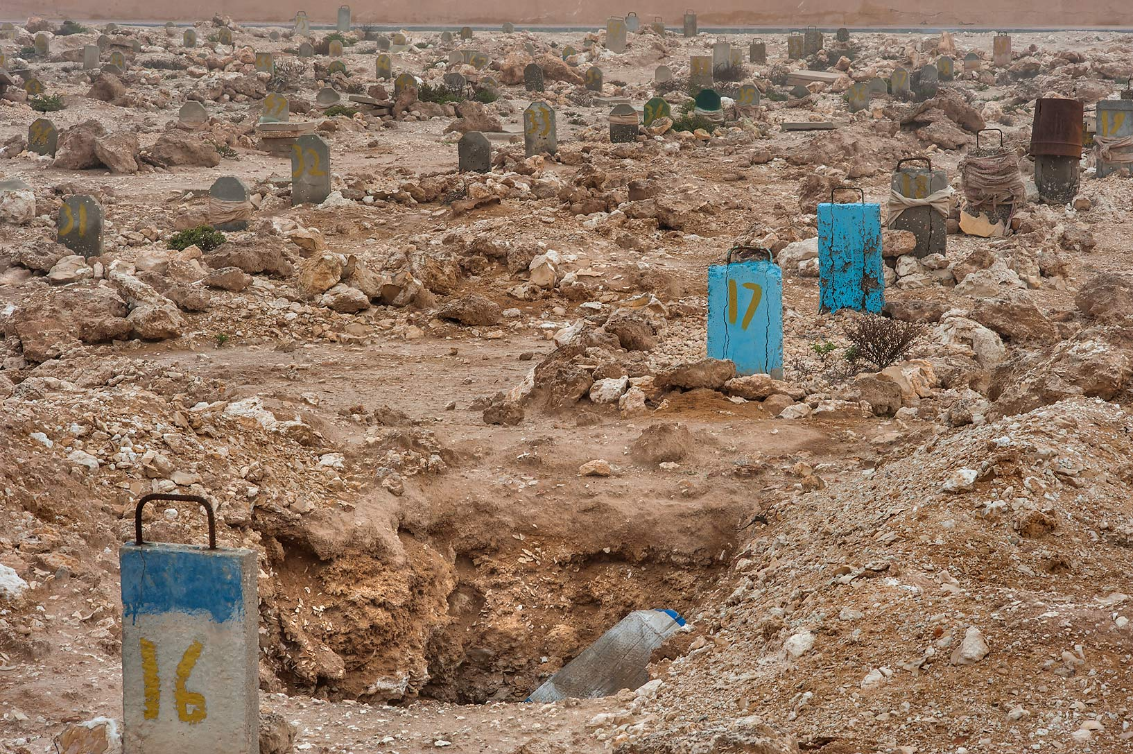 Colorful blue tombstones in Al Khor Cemetery. North from Al Khor, Qatar