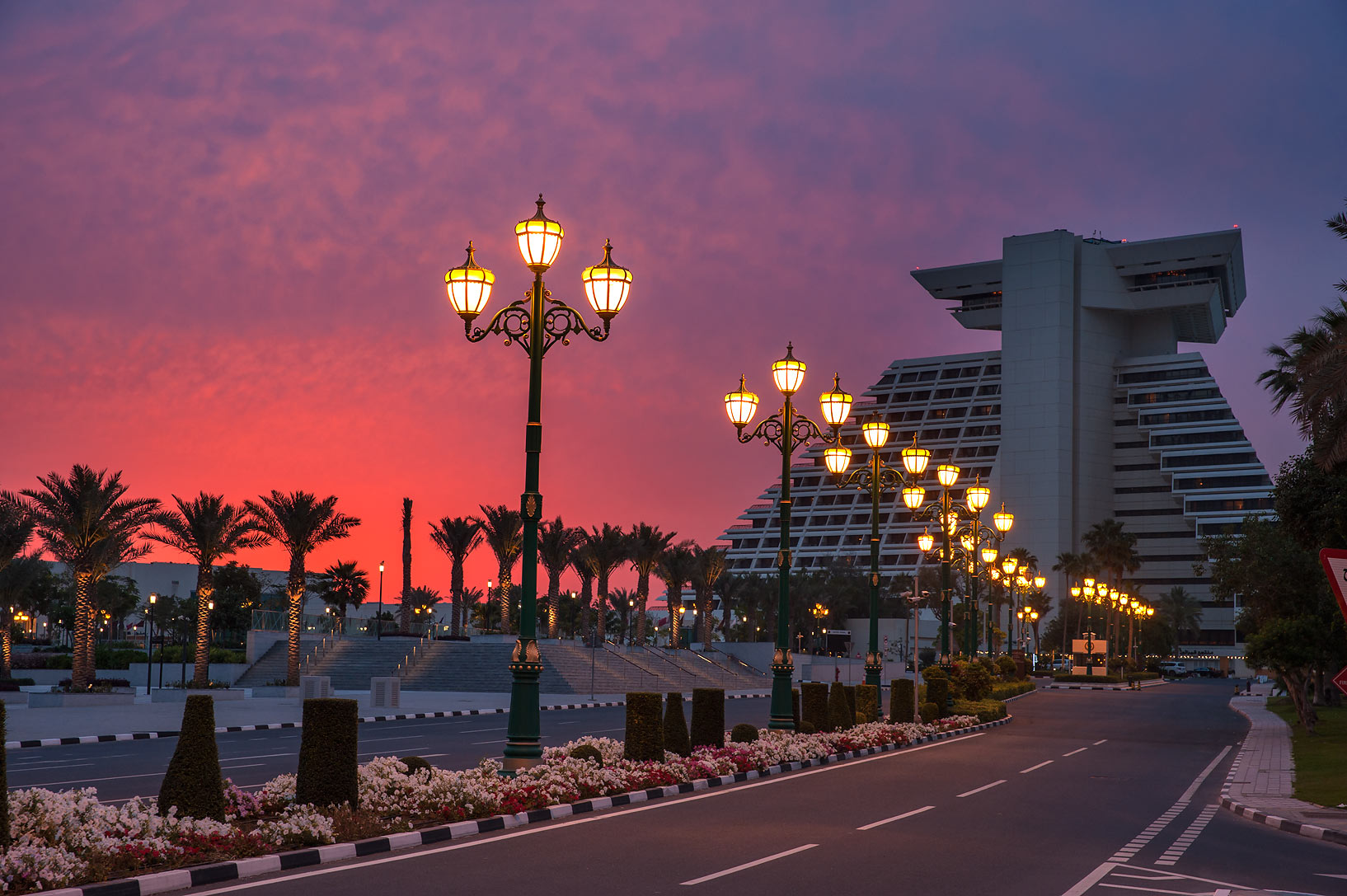 Sheraton Hotel at sunrise from Corniche St.. Doha, Qatar