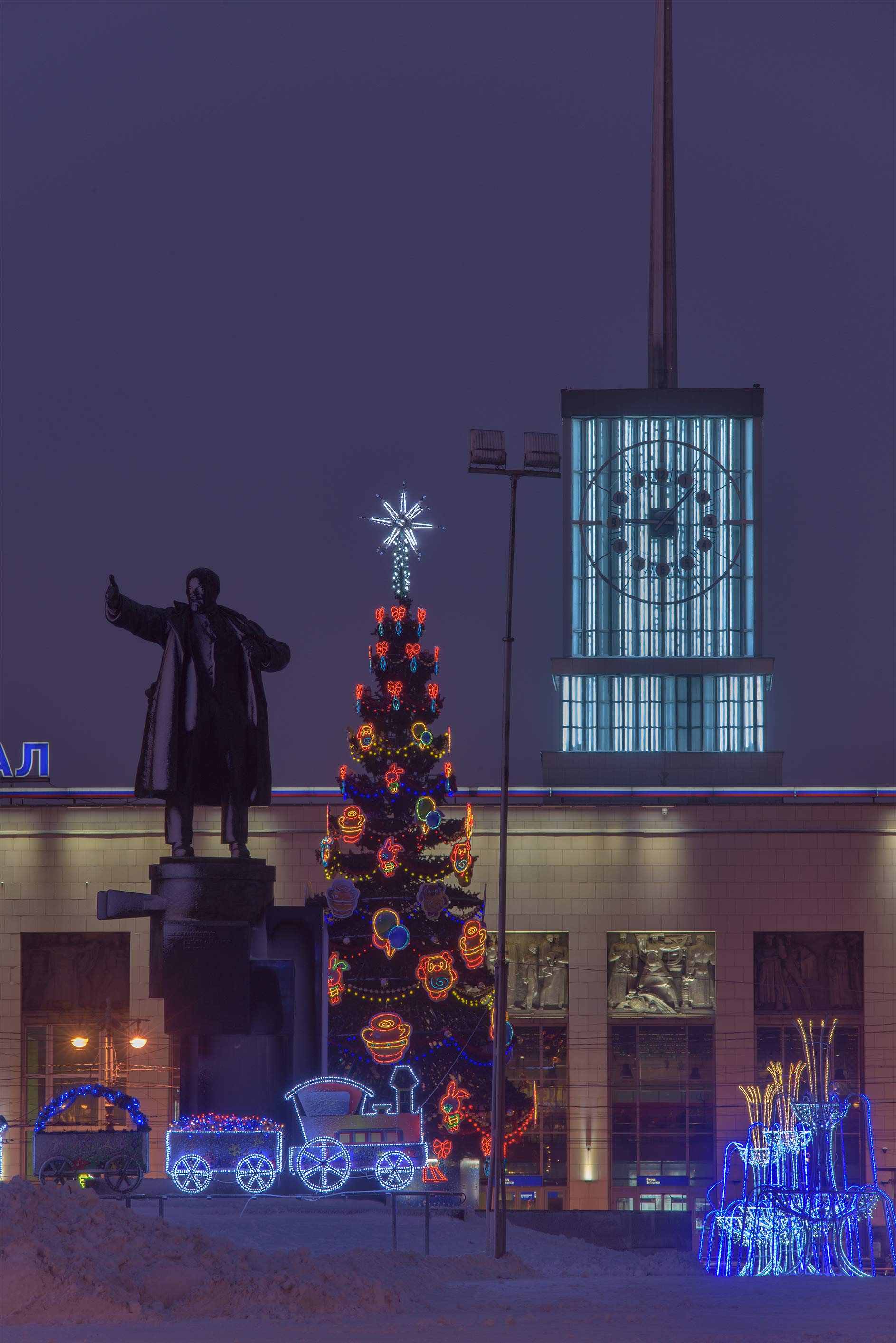 A Christmas tree and a monument of V. I. Lenin on...Train Station. St.Petersburg, Russia
