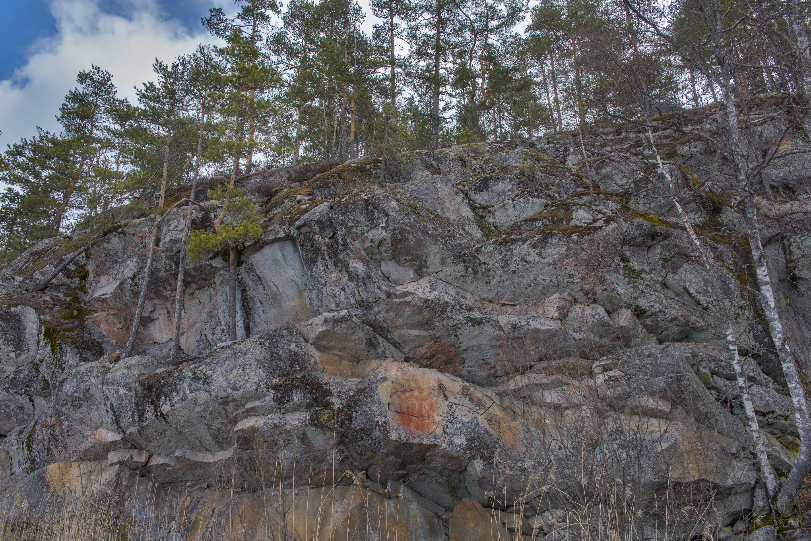 Rock paintings on steep cliff faces at Lake Saimaa in Kolmiköytisenvuori. Eastern Finland