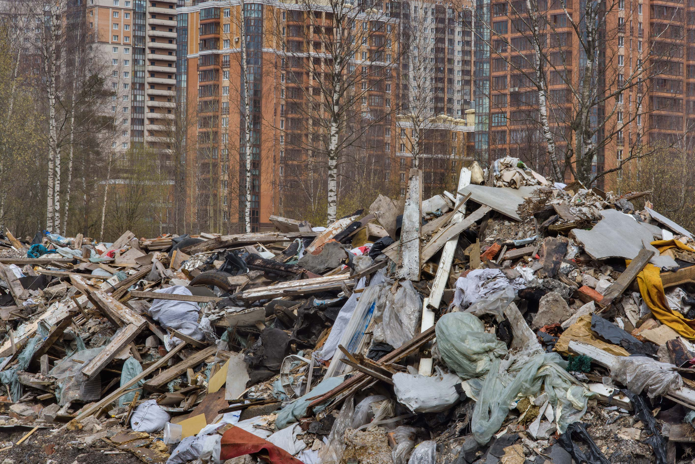 Piles of trash from former garages in area of...Sosnovka Park. St.Petersburg, Russia