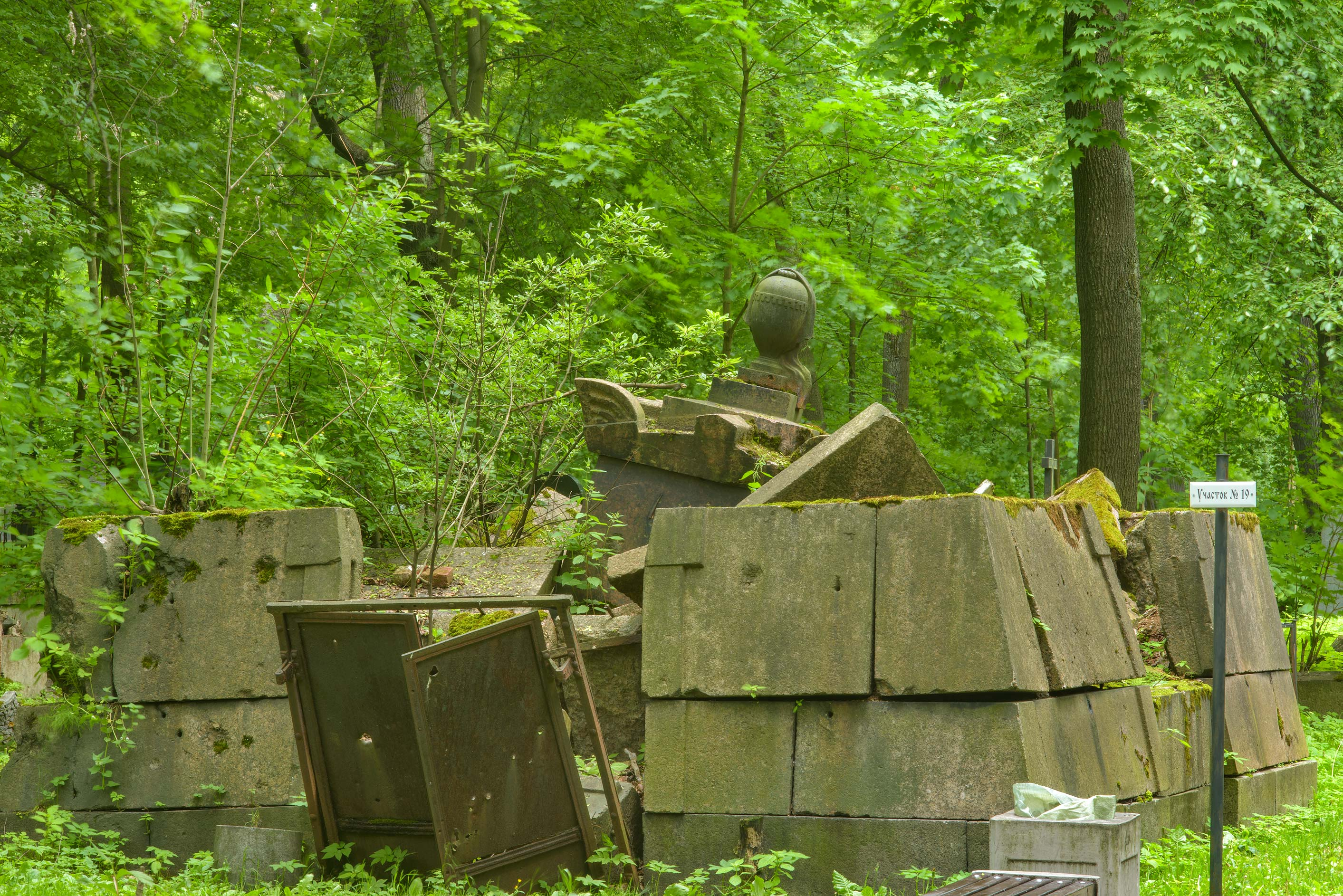 Collapsed granite tomb in Smolenskoe Cemetery of...Island. St.Petersburg, Russia