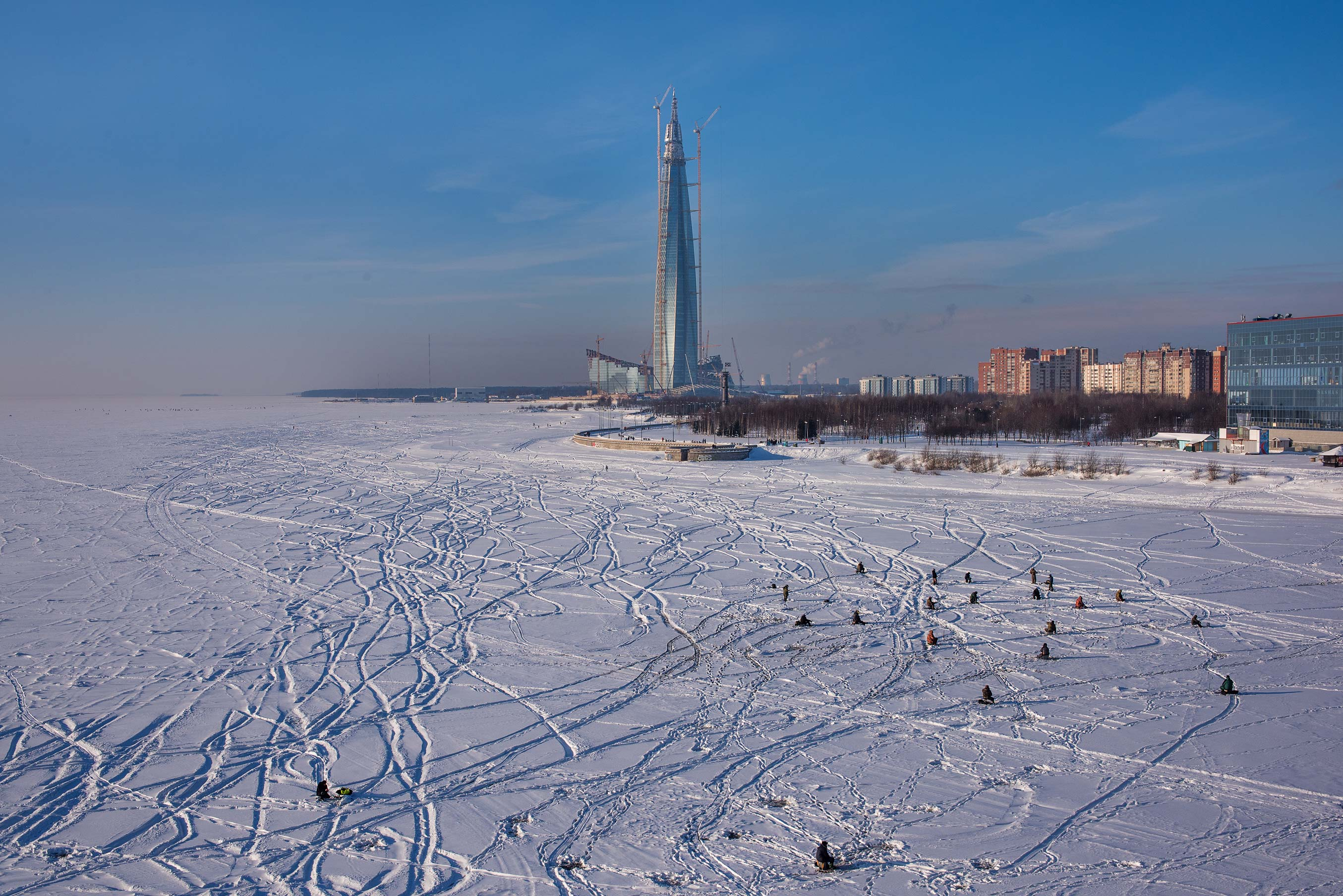 Ice fishing on Sobakina Flats from Yakhtenny Bridge. St.Petersburg, Russia